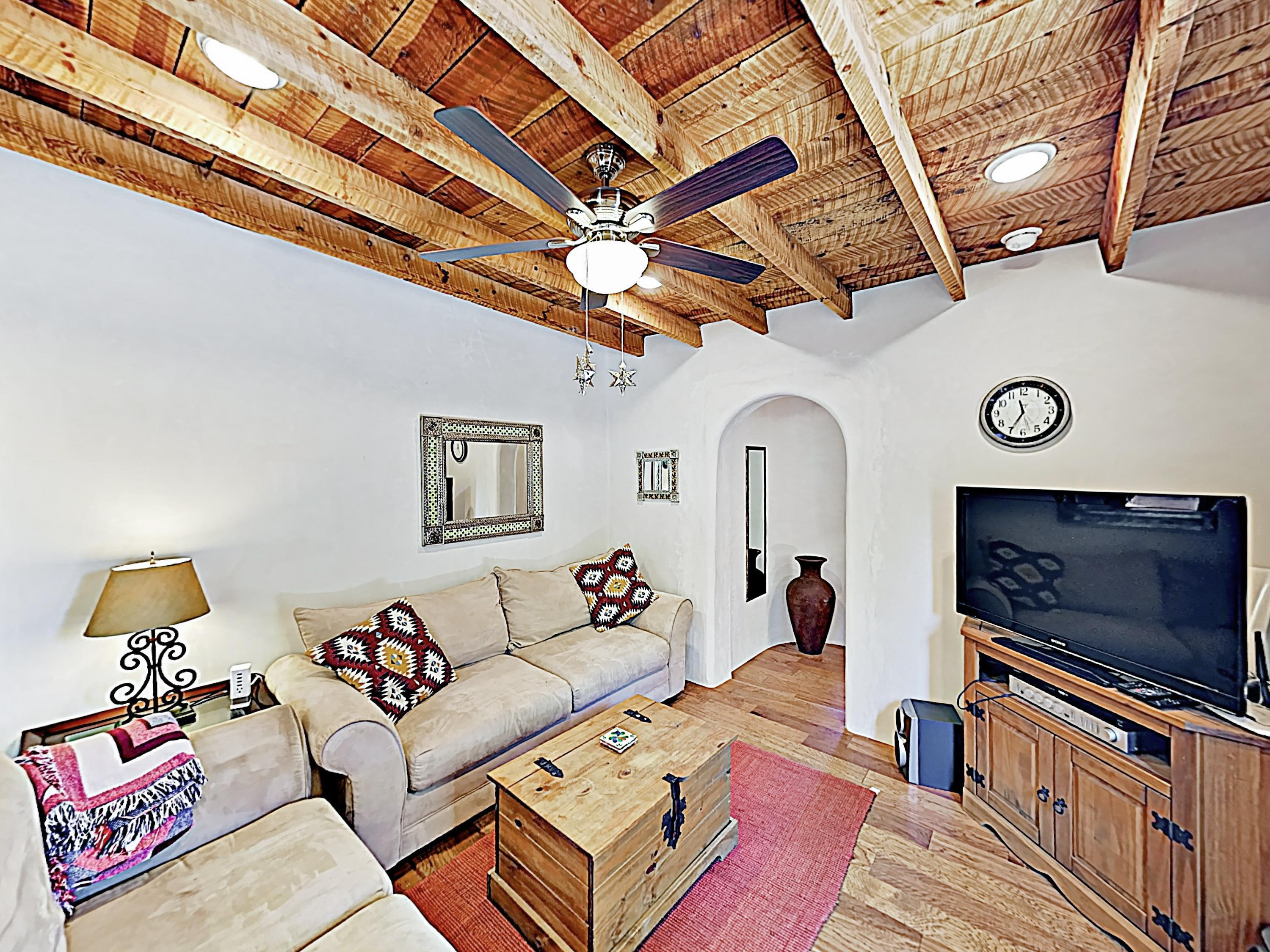 Wood beam ceilings add classic Southwestern charm throughout the 1,200 square foot floor plan.