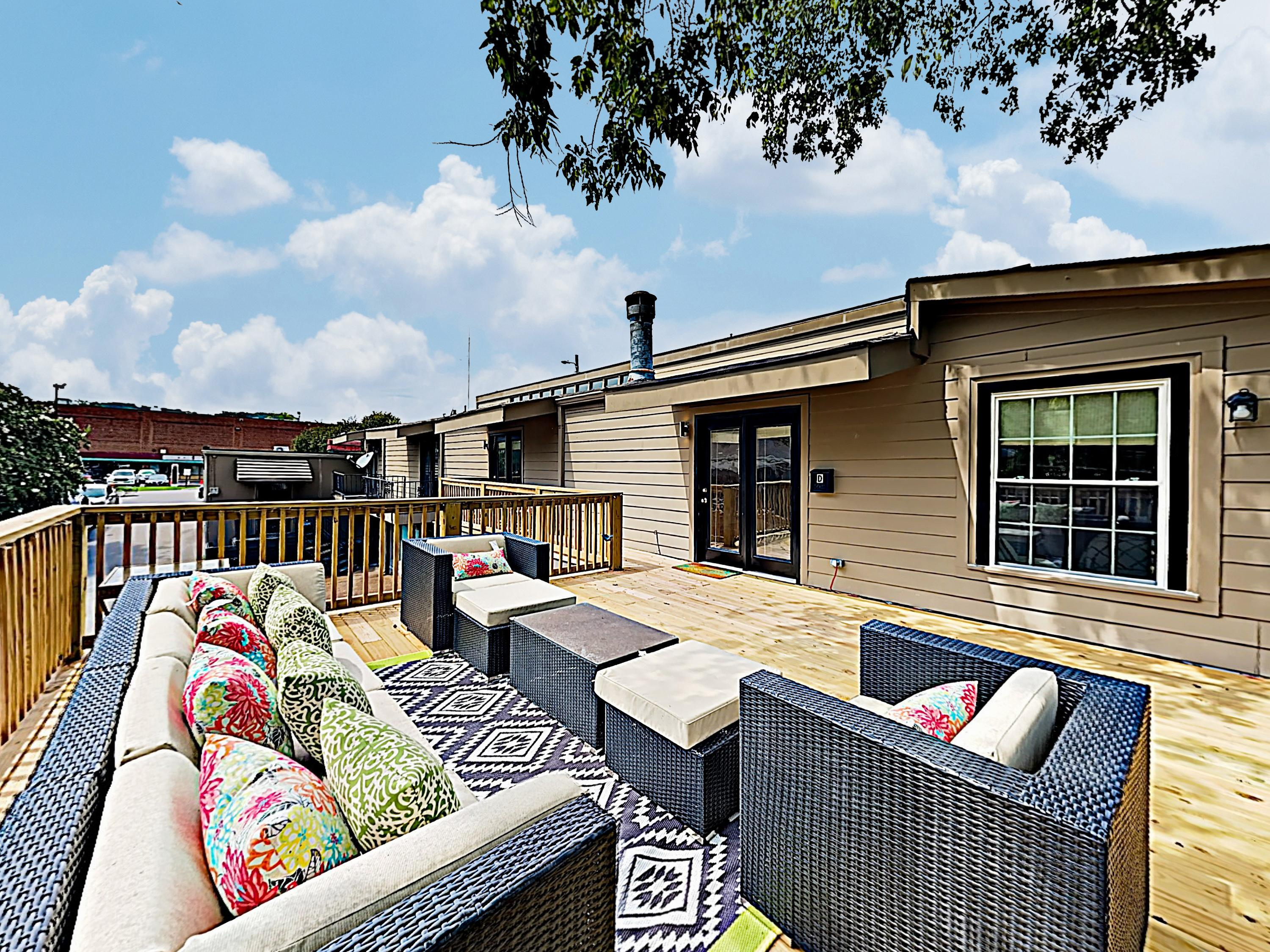 Relax outside on the expansive wooden deck, furnished with wicker seating for 6.