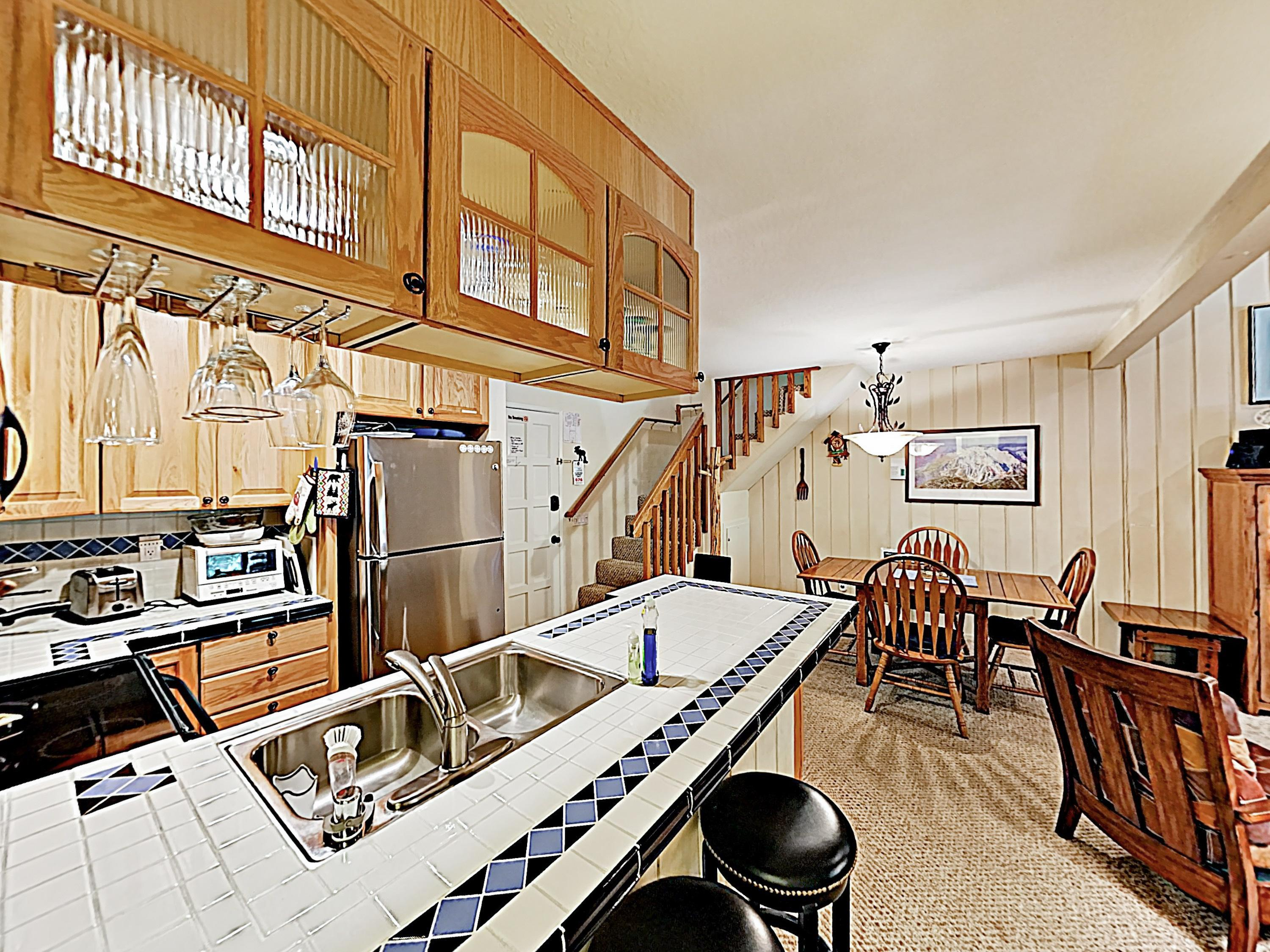 Whip up hot meals in the fully stocked kitchen, furnished with accent tile countertops and quality appliances.