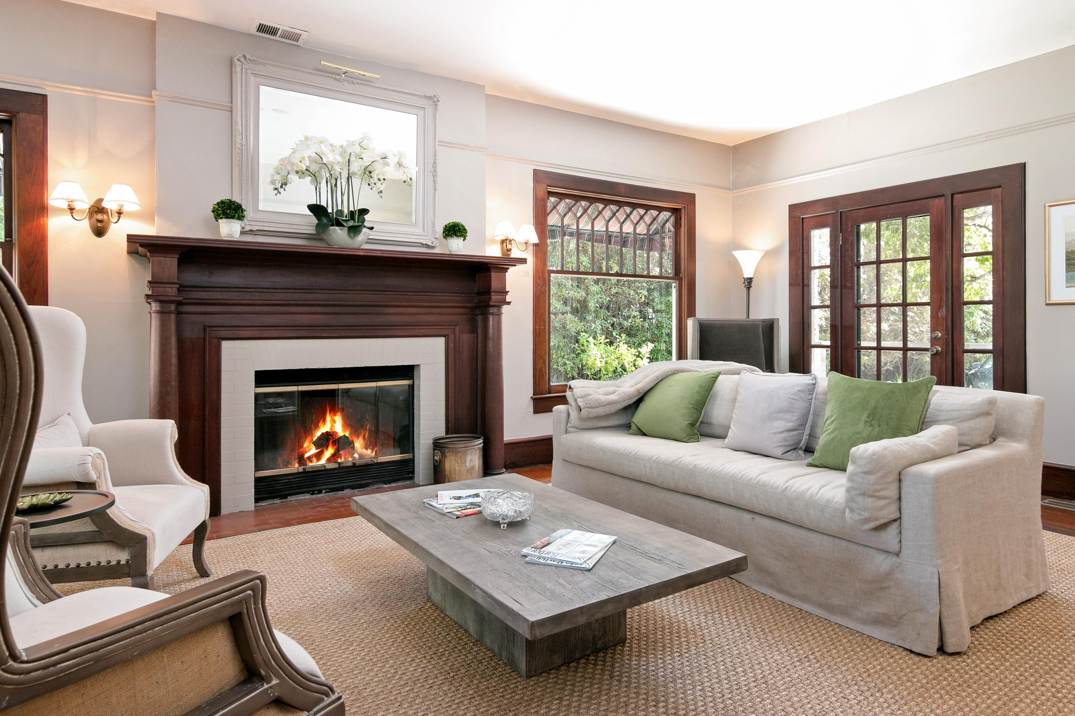 A wood-burning fireplace adds ambience to the living room.