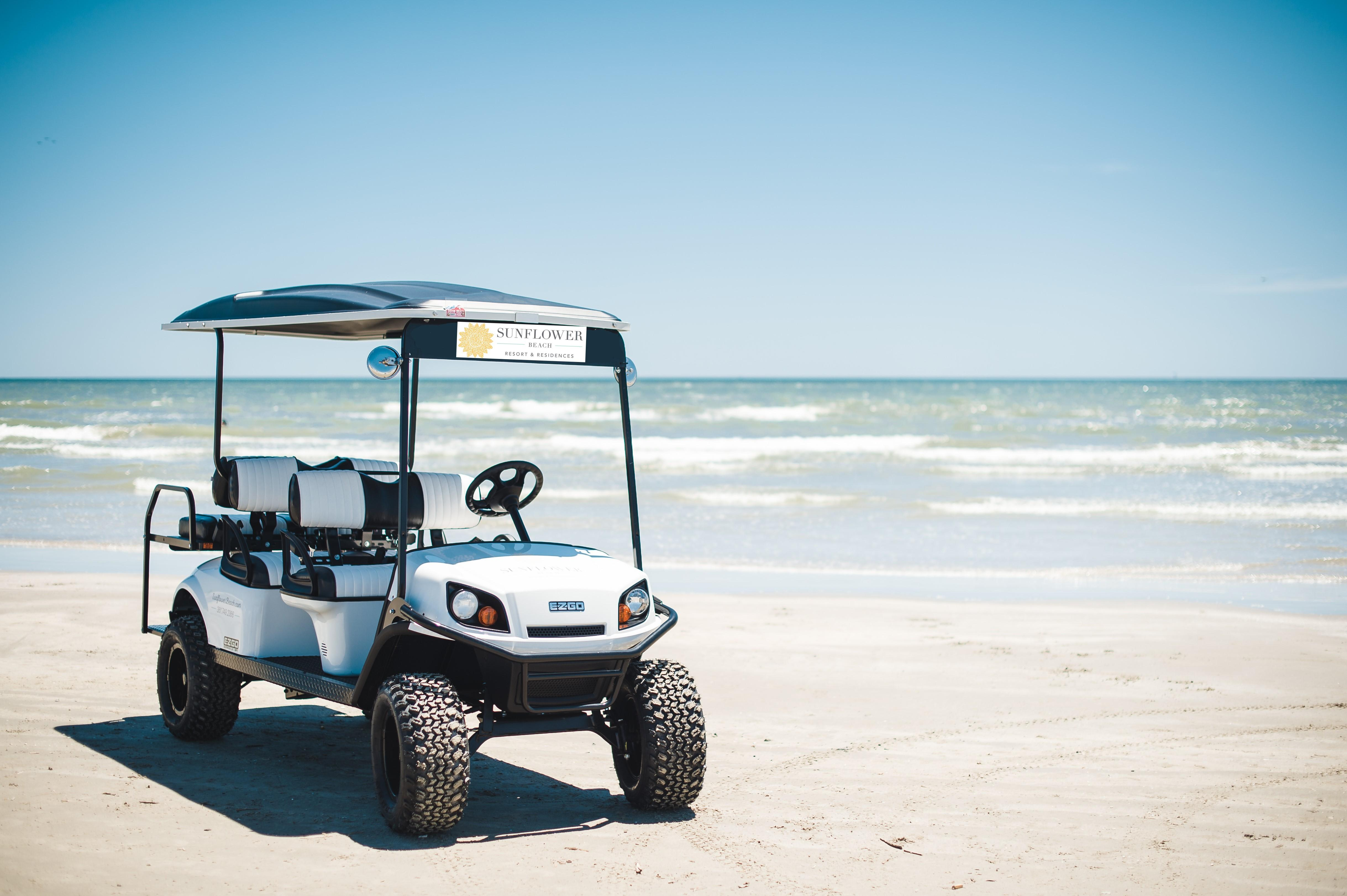 Cruise along the coast in a 6-seat golf course -- available to rent on-site.