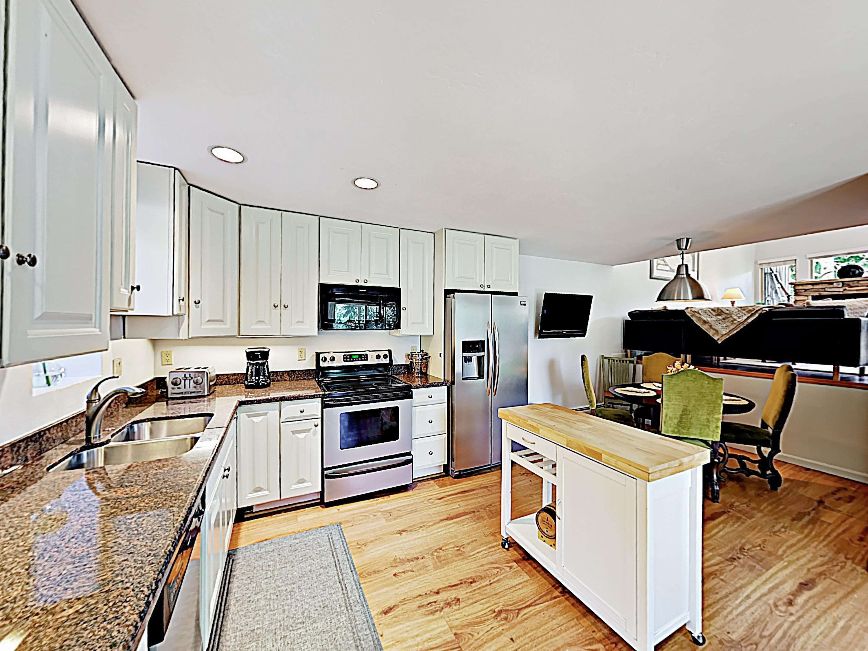 Whip up hearty recipes in the fully stocked kitchen, detailed with granite countertops and stainless steel appliances.