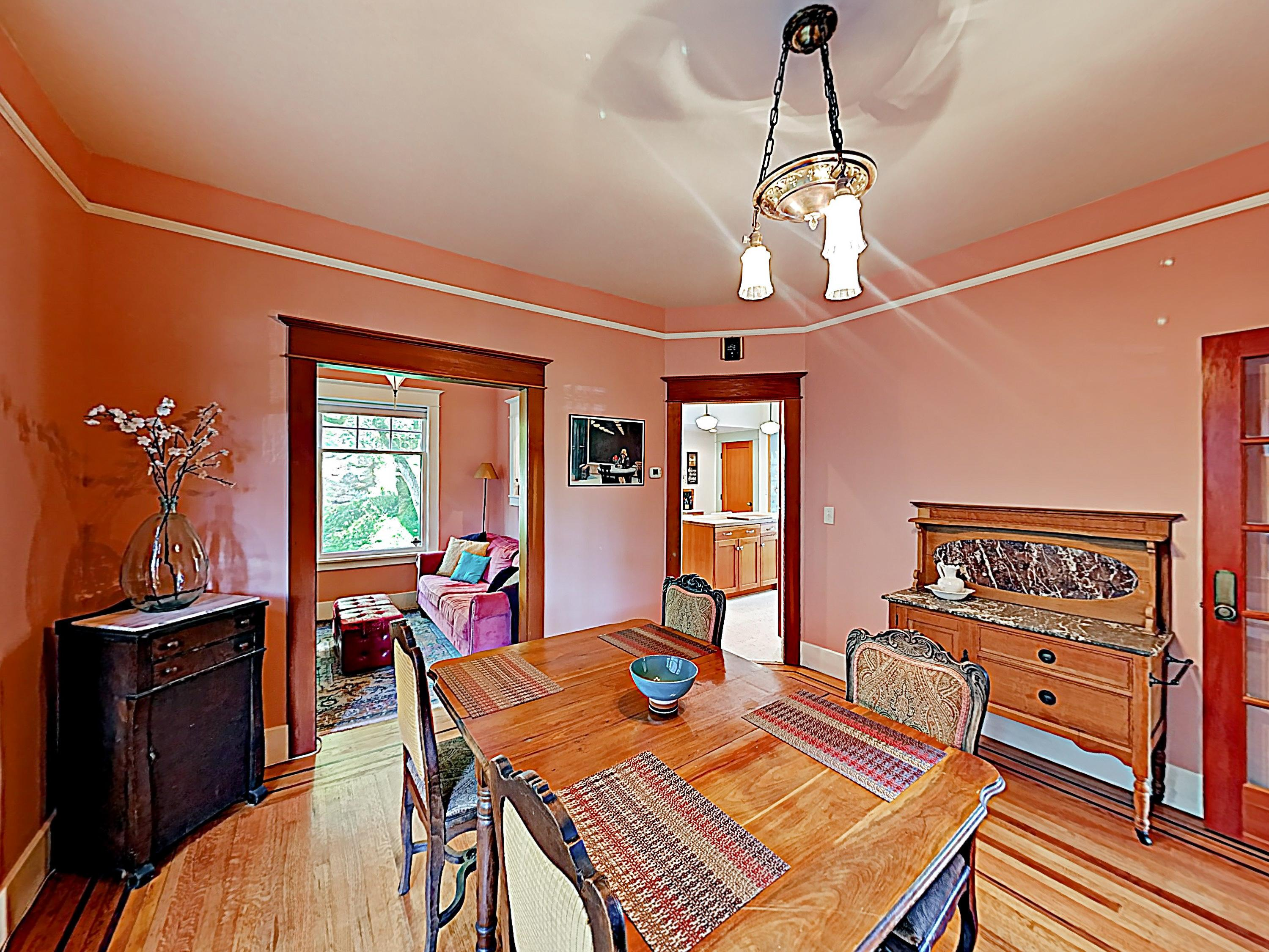 Share meals in the formal dining room, outfitted with a wood table and a granite buffet.