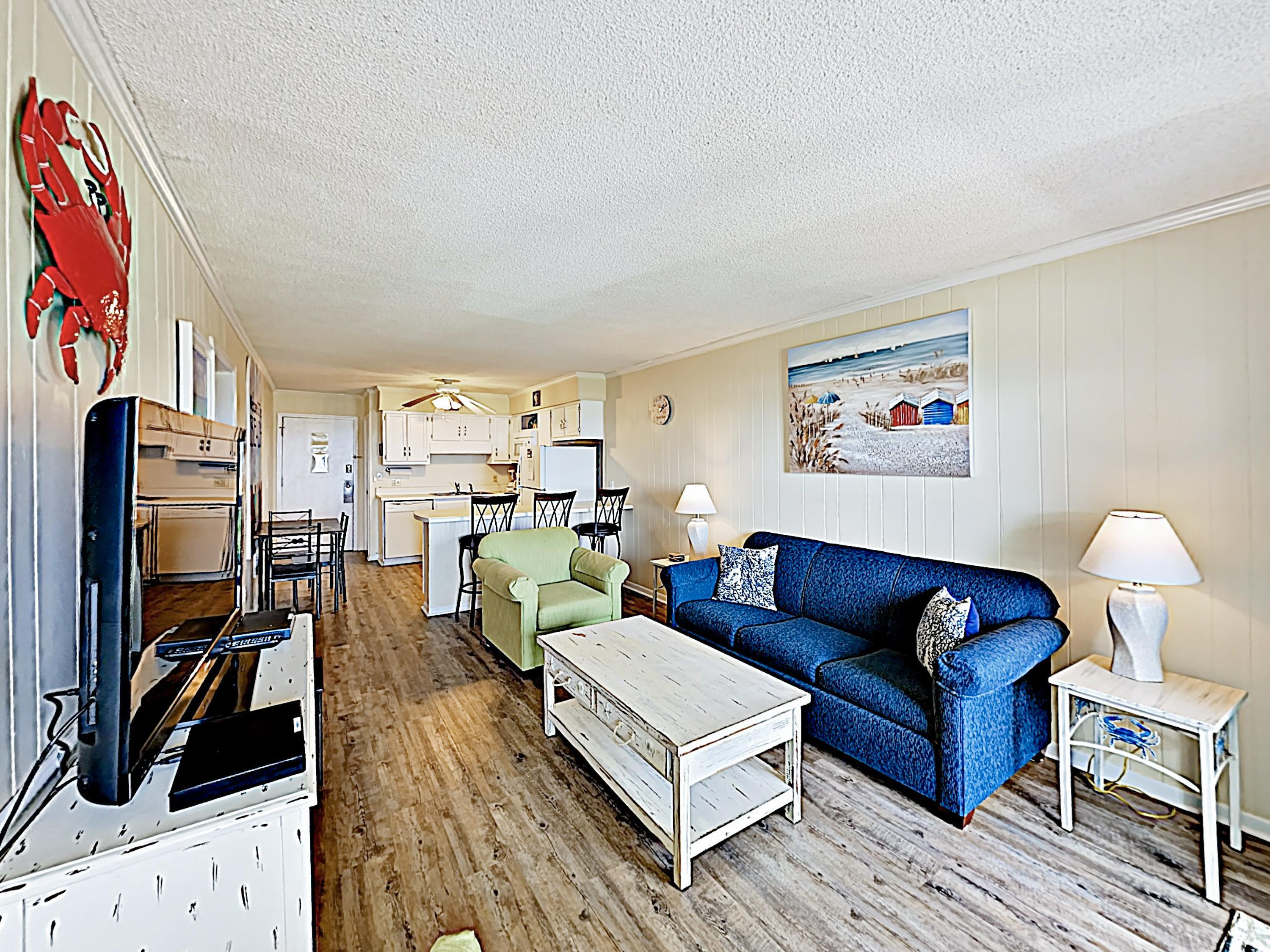 "A living area with beachy decor includes a queen-size sleeper sofa and 46"" flat-screen TV."