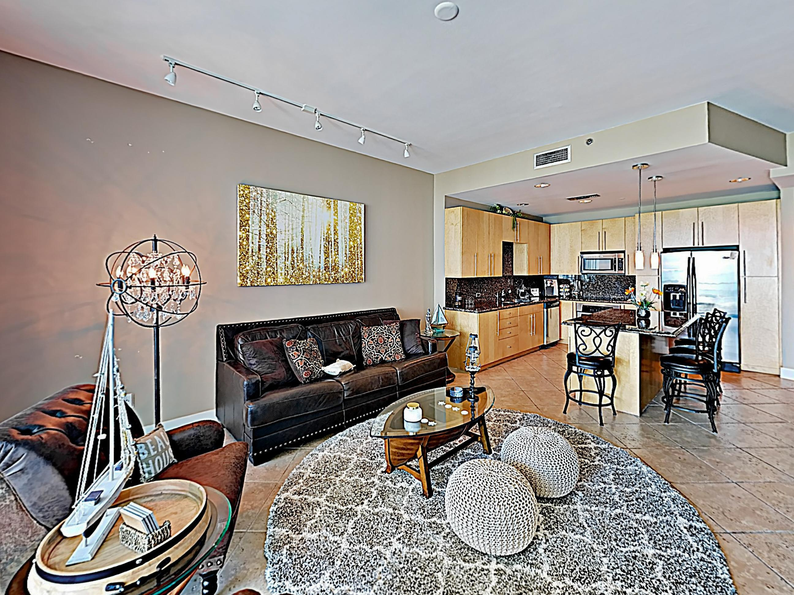 10' foot ceilings soar in the sophisticated living area, complete with high-end furnishings.