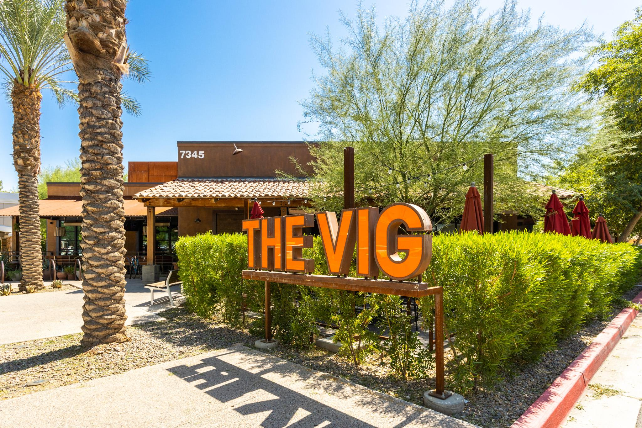 Enjoy happy hour on the patio at the Vig, also at The Grove.