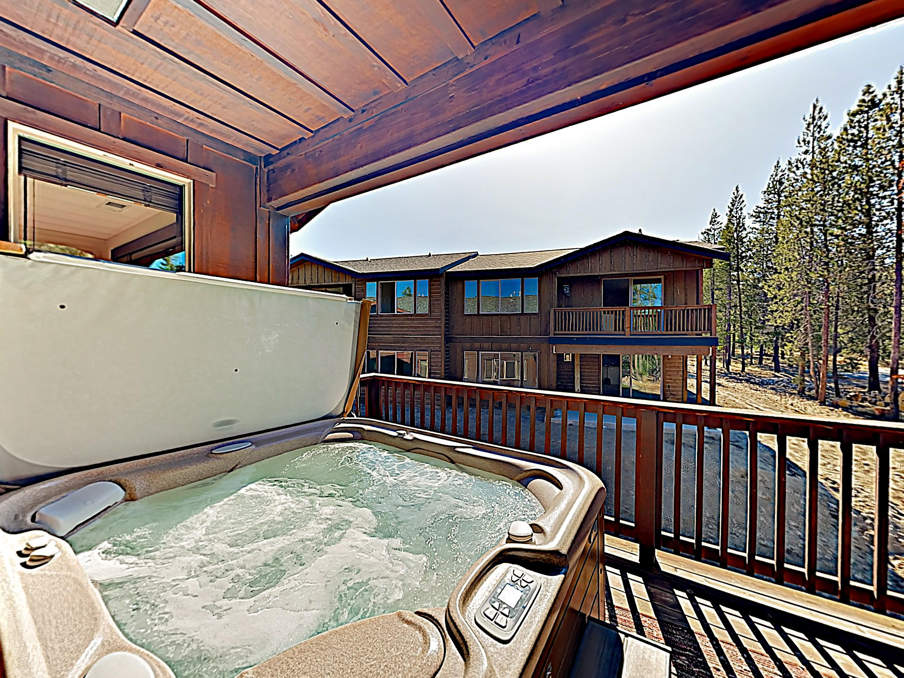 Unwind after your adventures in the private hot tub on the balcony.