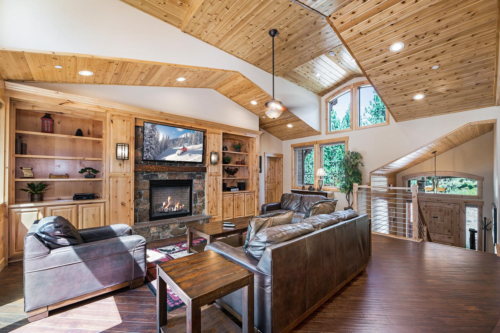 Stunning architectural features include vaulted ceilings, huge windows, and tasteful woodwork.