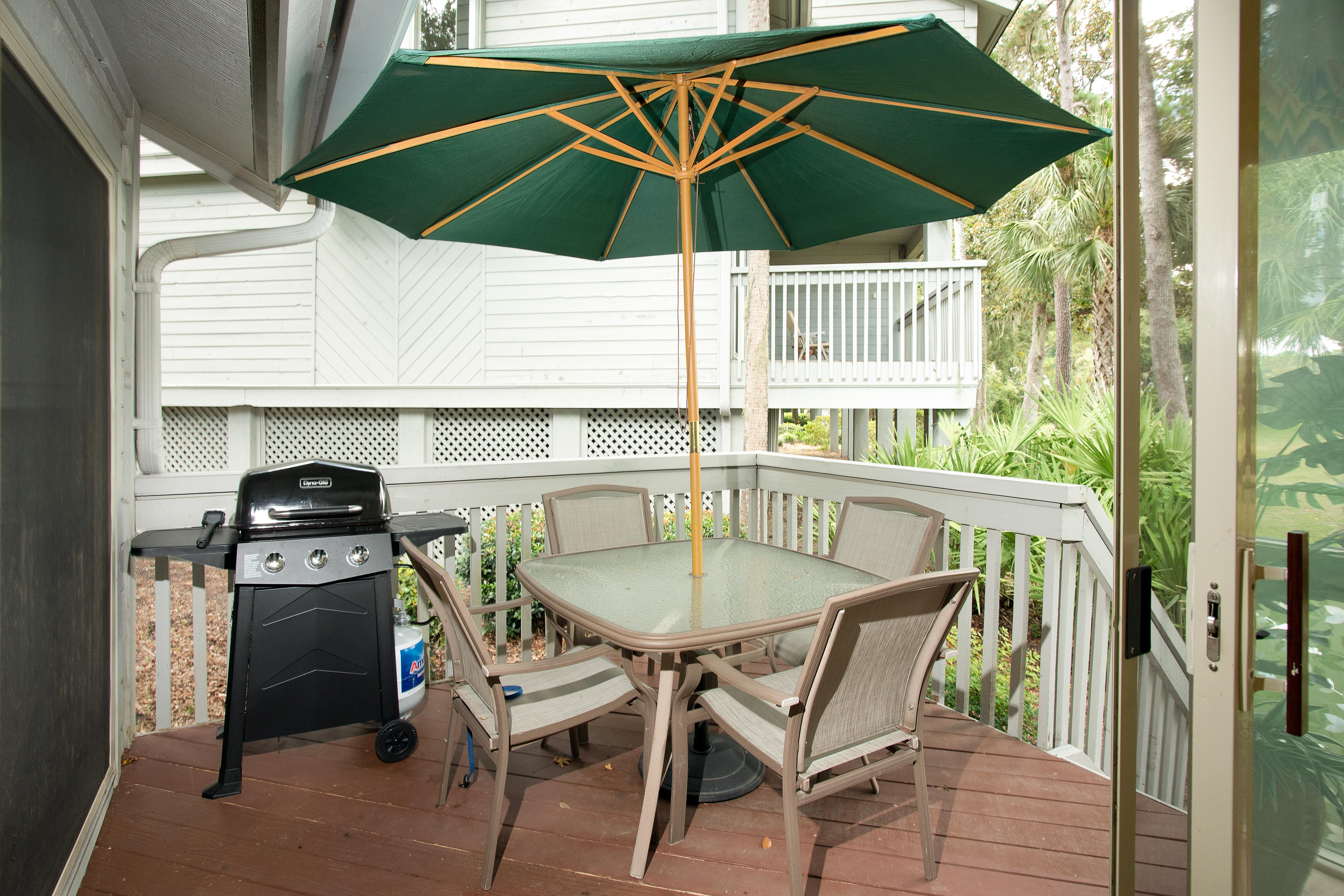Sizzle steaks and dine alfresco on the back patio.