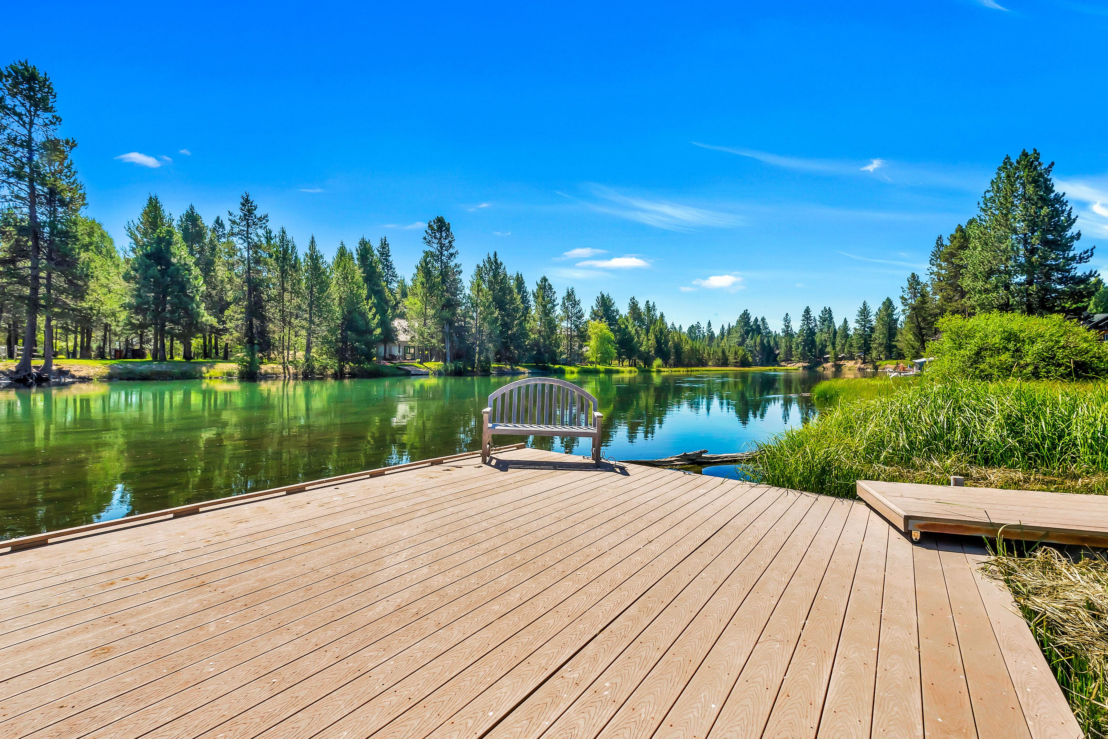 Relax on the backyard dock by the lovely Deschutes River.