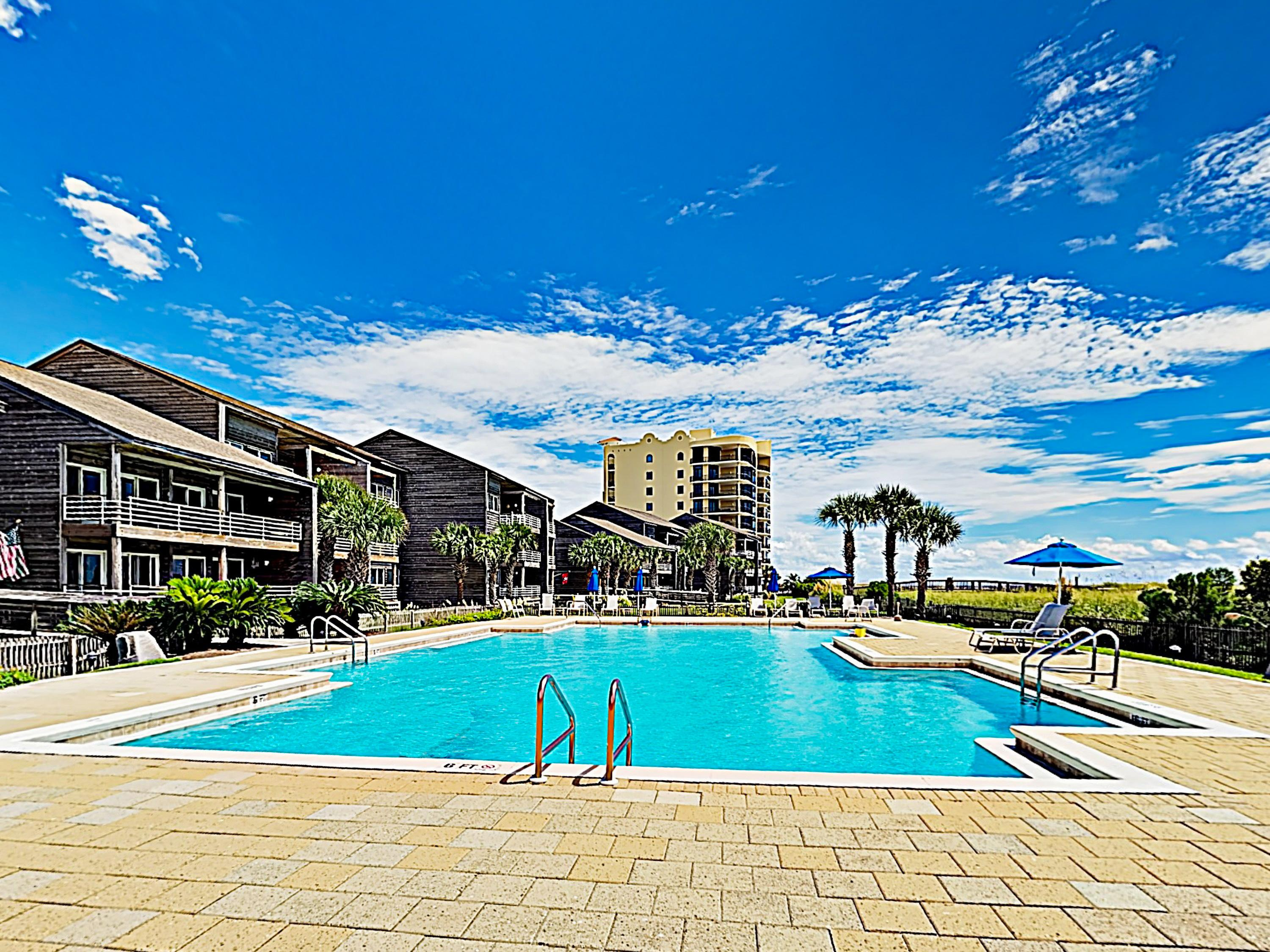 2 sparkling pools invite you to swim alongside Gulf and Old River views.
