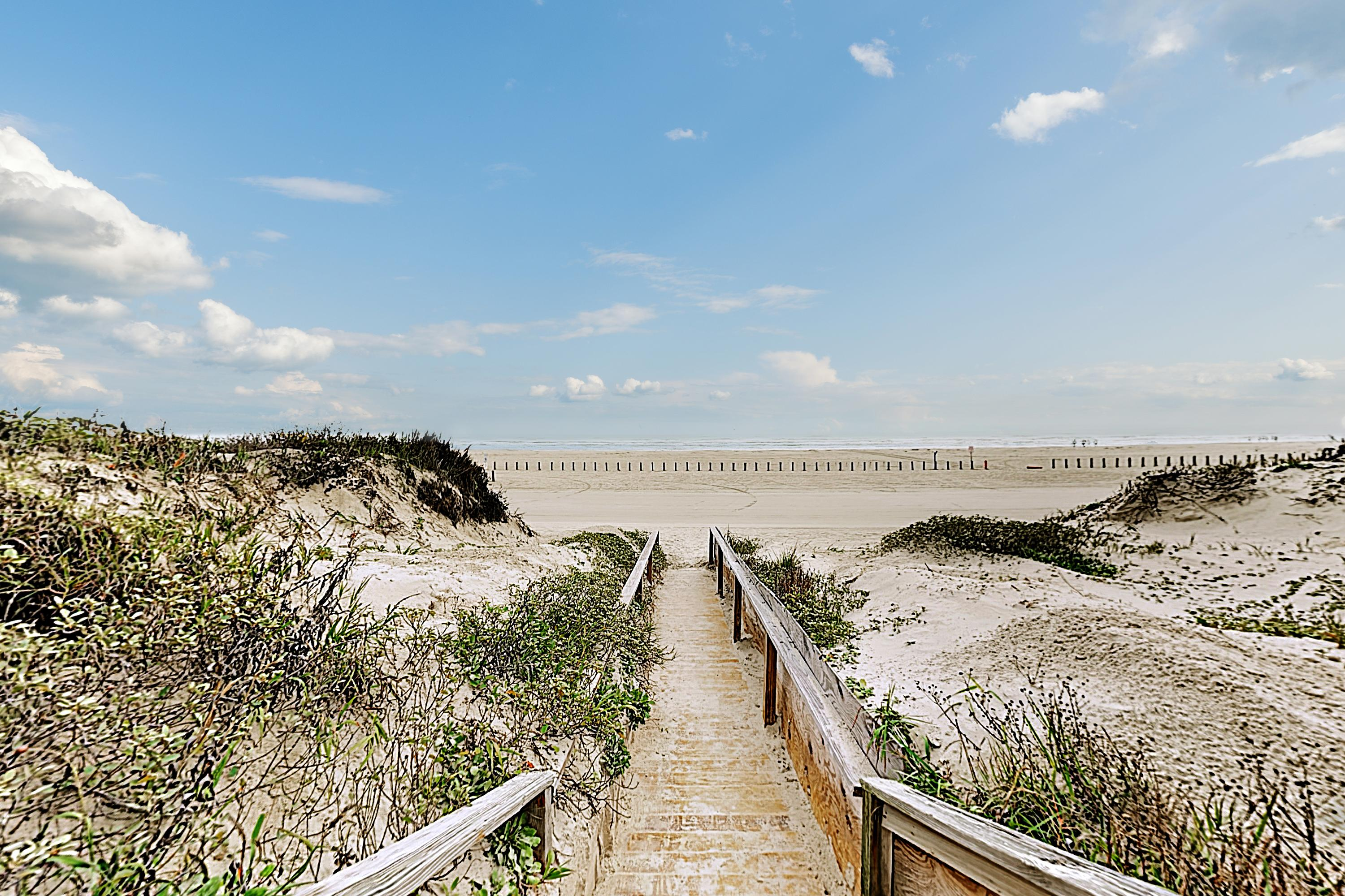 A quick stroll down the boardwalk leads you directly to the beach!