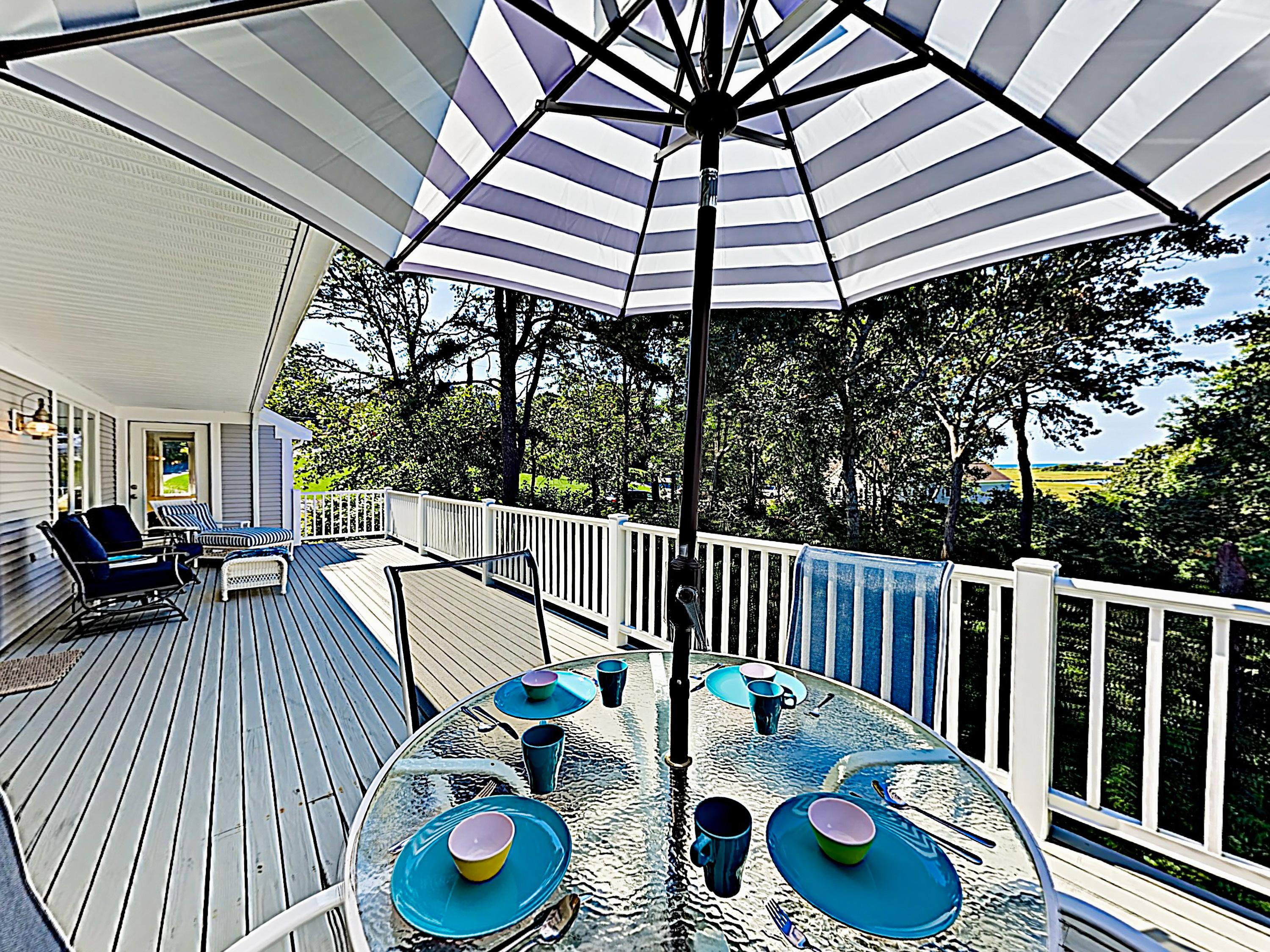 The spacious deck offers peekaboo views of the Red River Marsh and Nantucket Sound.