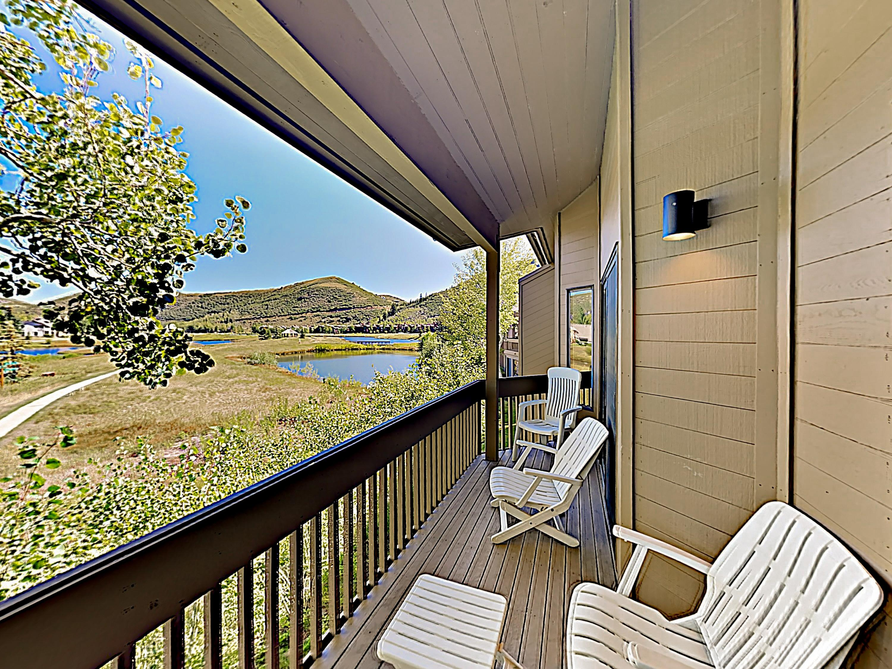 Relax in the fresh mountain air on the balcony, furnished with plenty of seating.