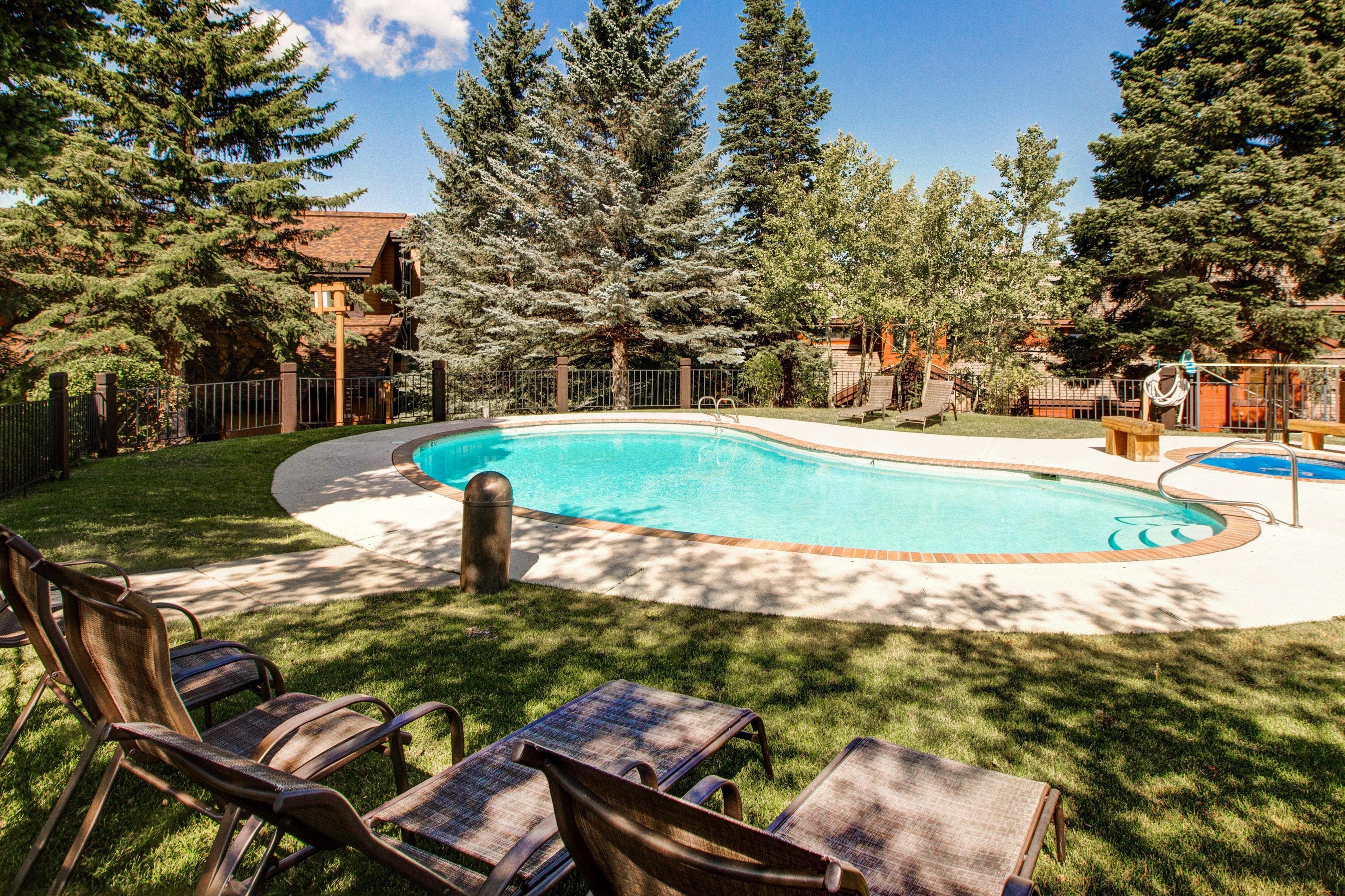 The shared pool and hot tub offer plenty of space to relax in the sun and shade.