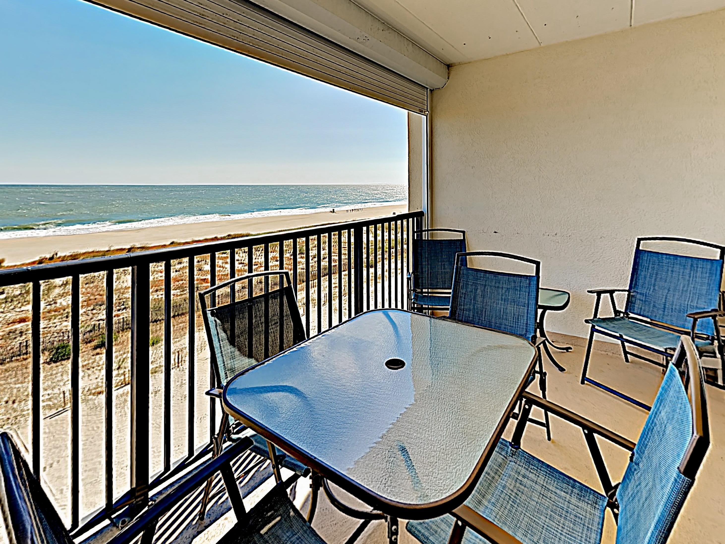 Enjoy the coastal breeze on the covered balcony.