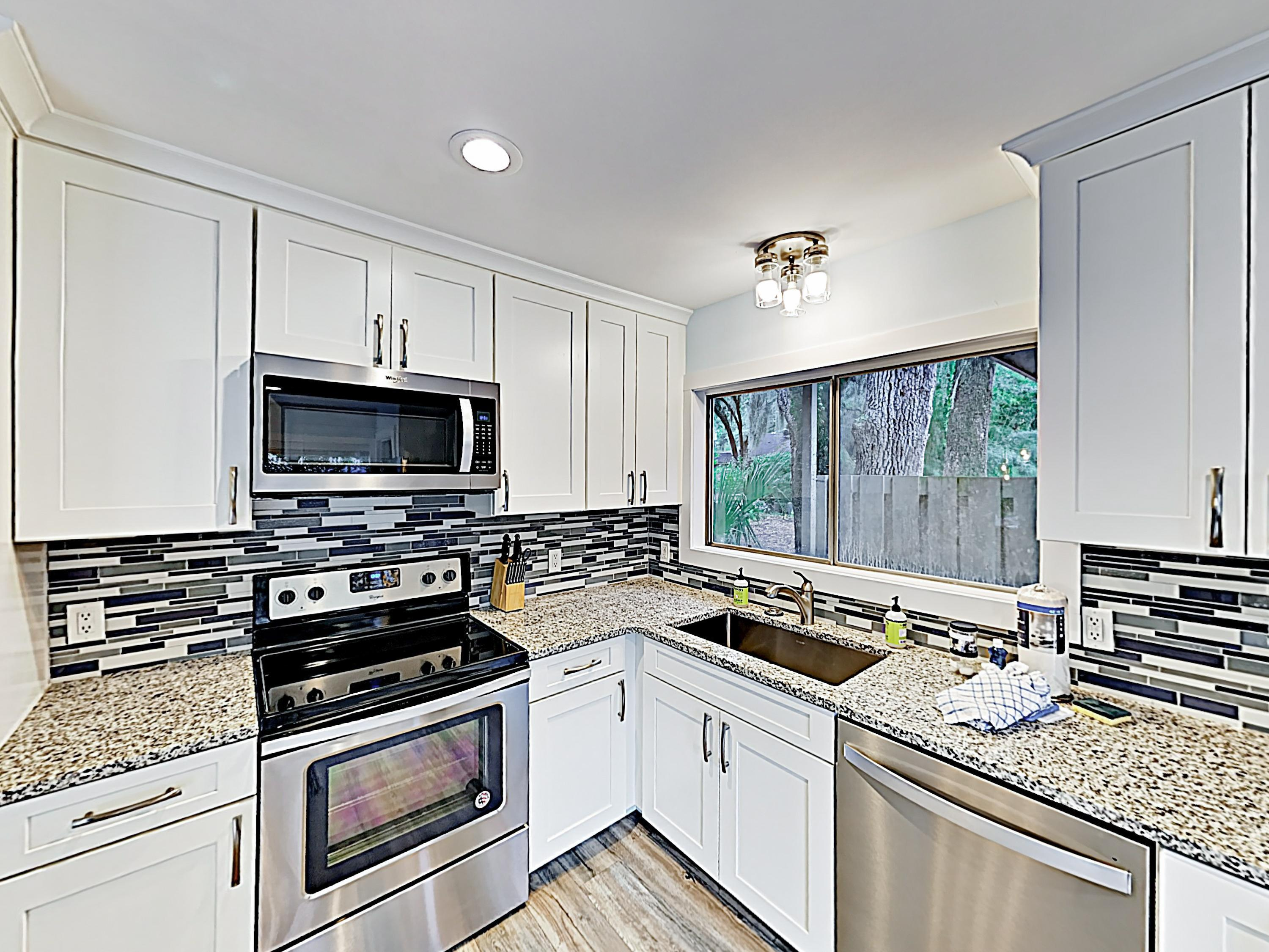 Whip up delicious meals in the kitchen, equipped with granite countertops and a full suite of appliances.
