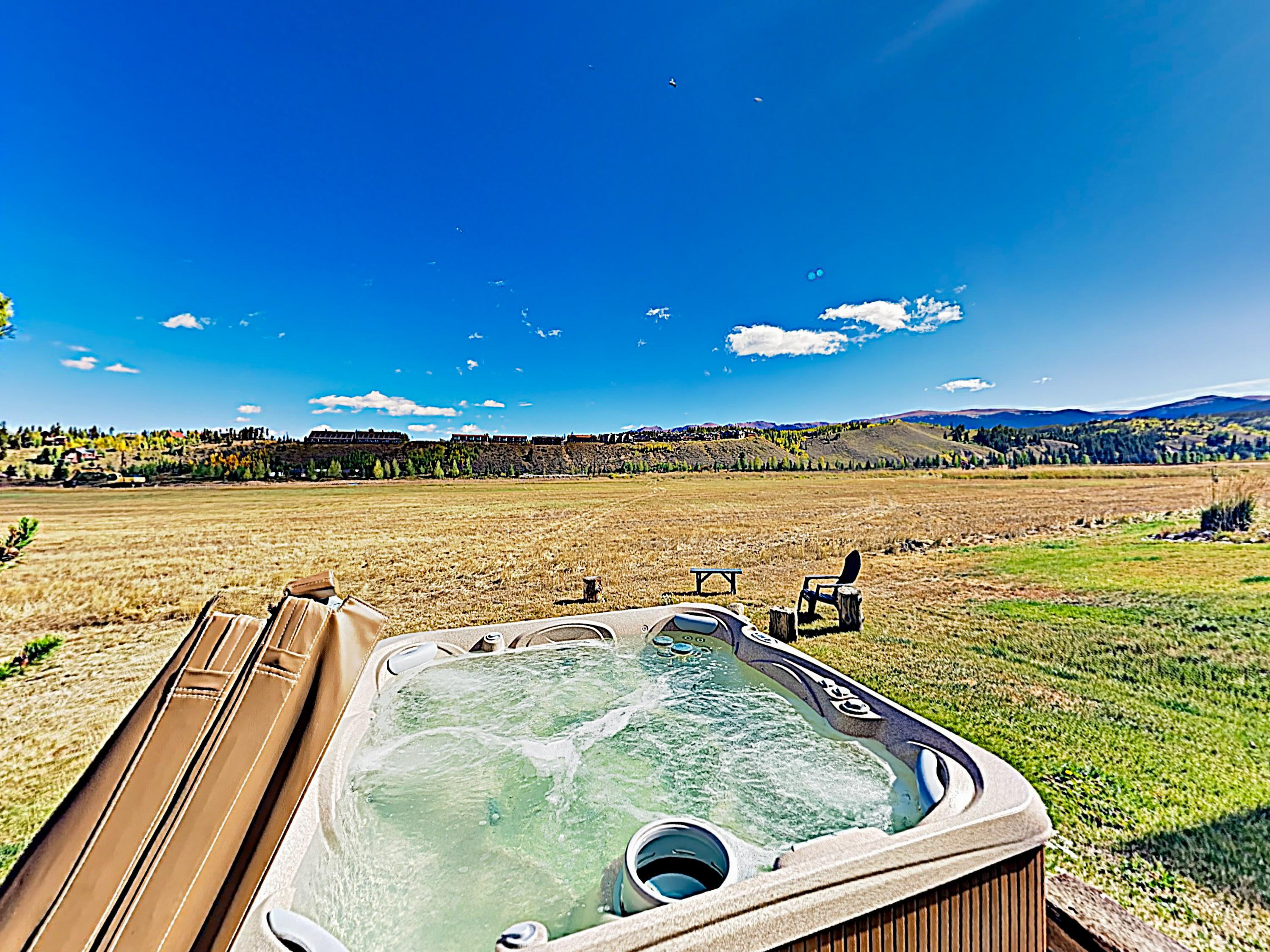 Unwind in your private mountain-view hot tub.