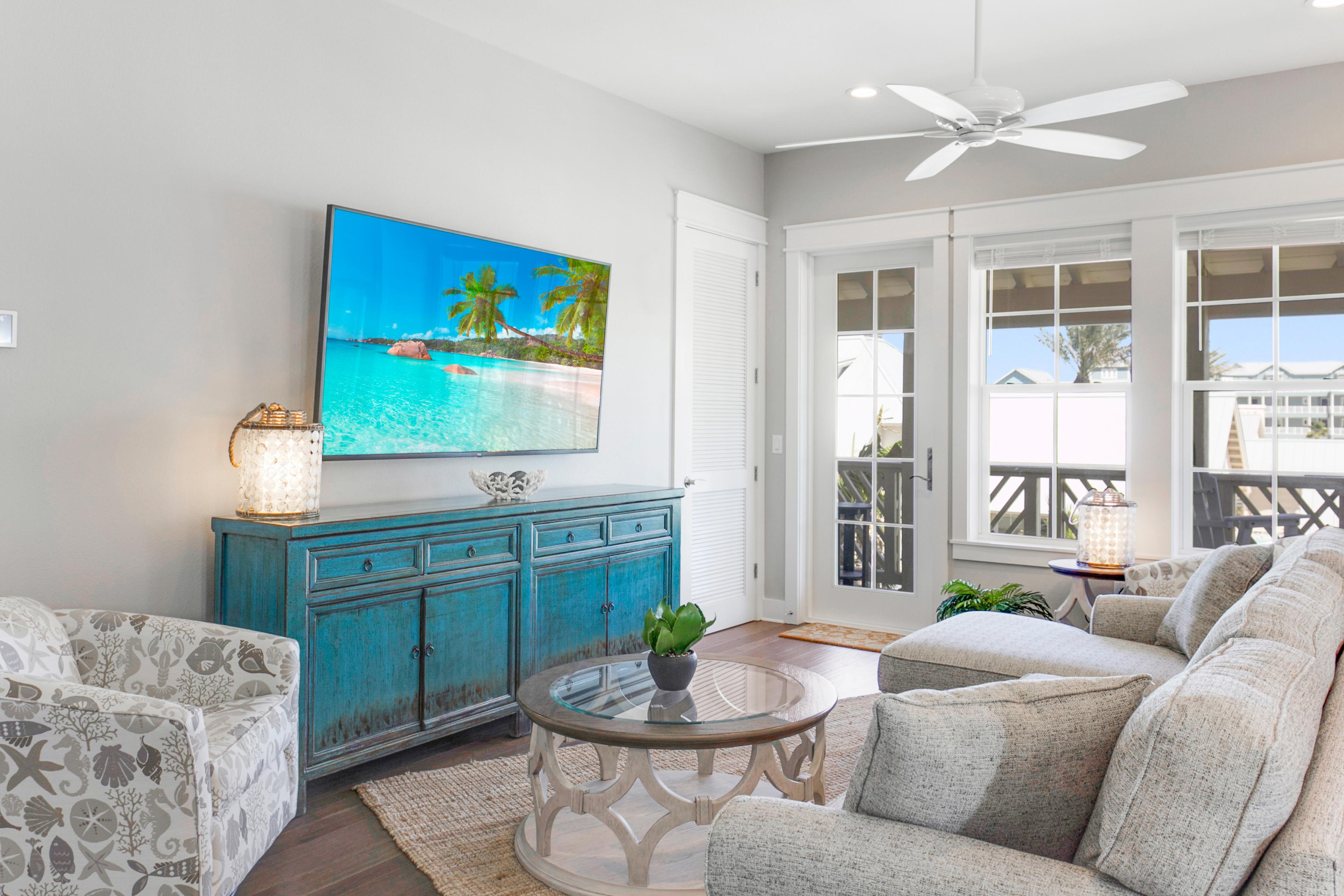 "The sun-drenched Great Room features a 65"" flat-screen and a plush queen-size sleeper sofa."