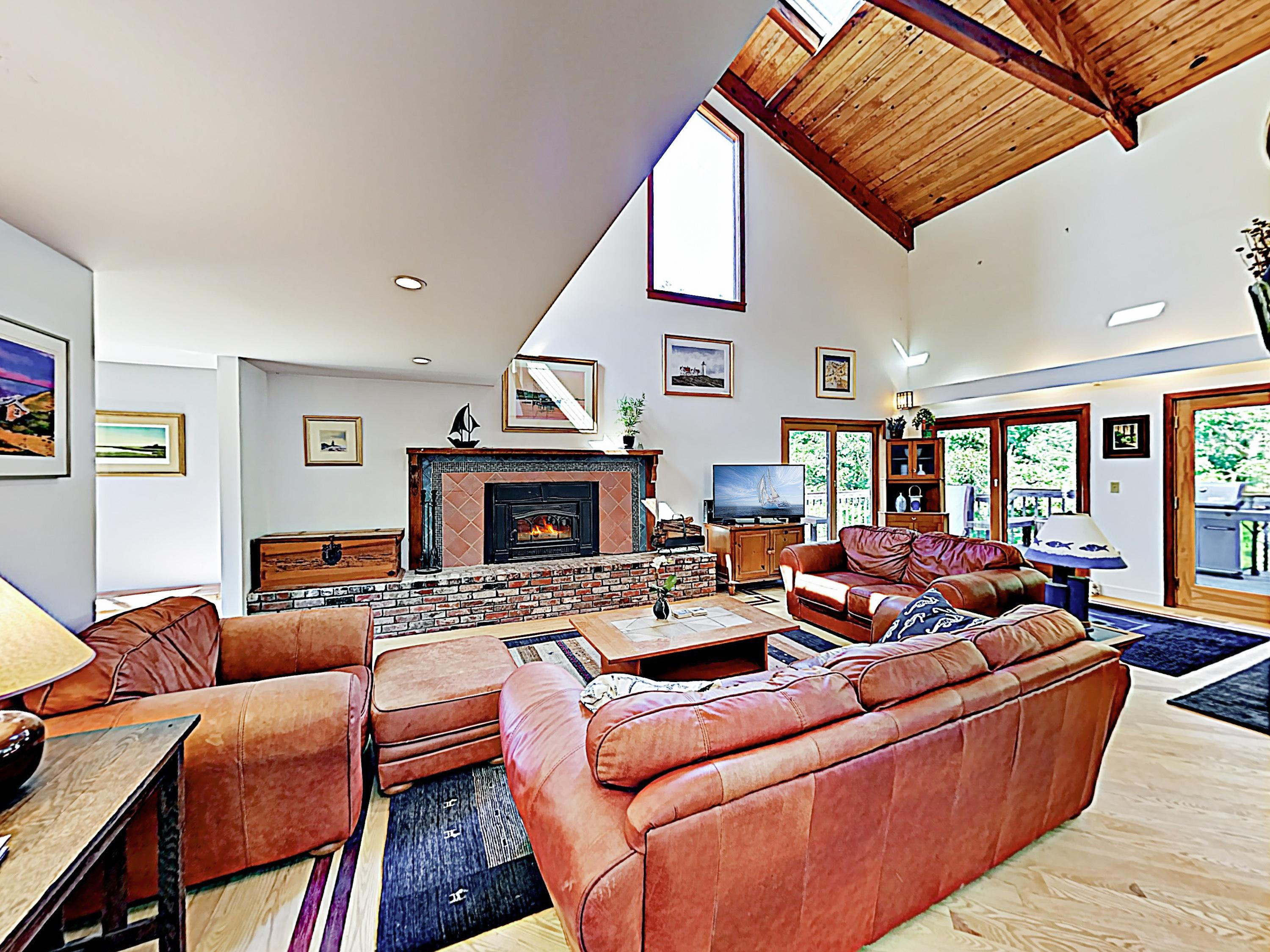 Soaring vaulted ceilings provide dramatic ambience in the expansive main living area.