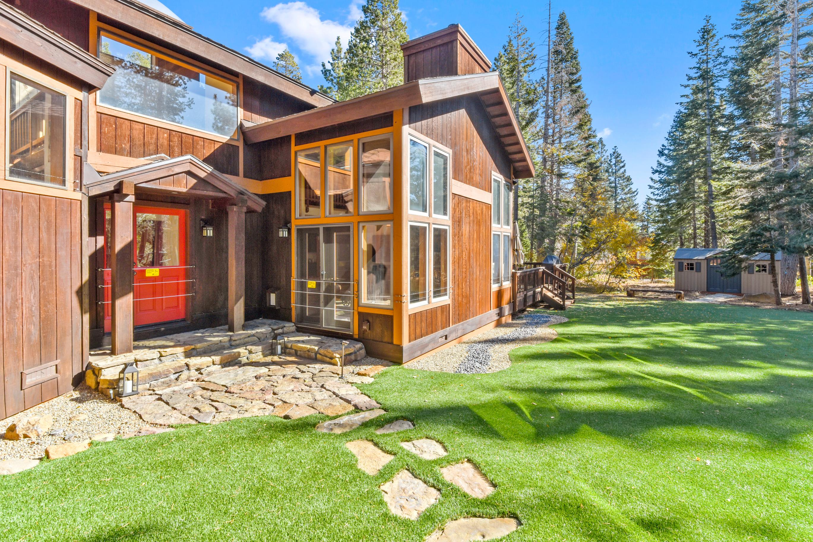 Welcome to Sugar Bear Lodge! This estate is professionally managed by TurnKey Vacation Rentals.Find plenty of room for family games in the front yard.