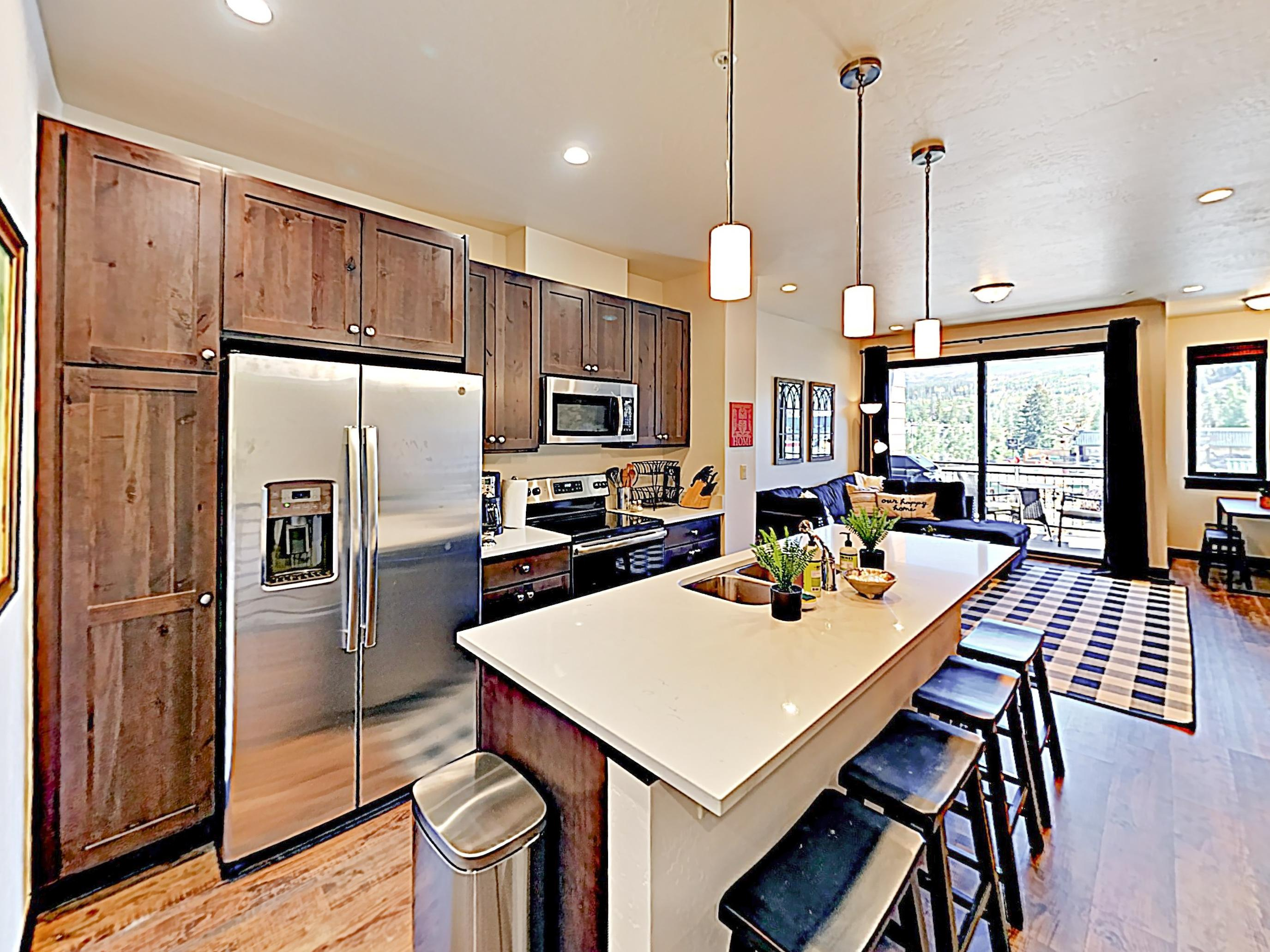 Channel your inner chef in an airy kitchen detailed with a full suite of stainless steel appliances.