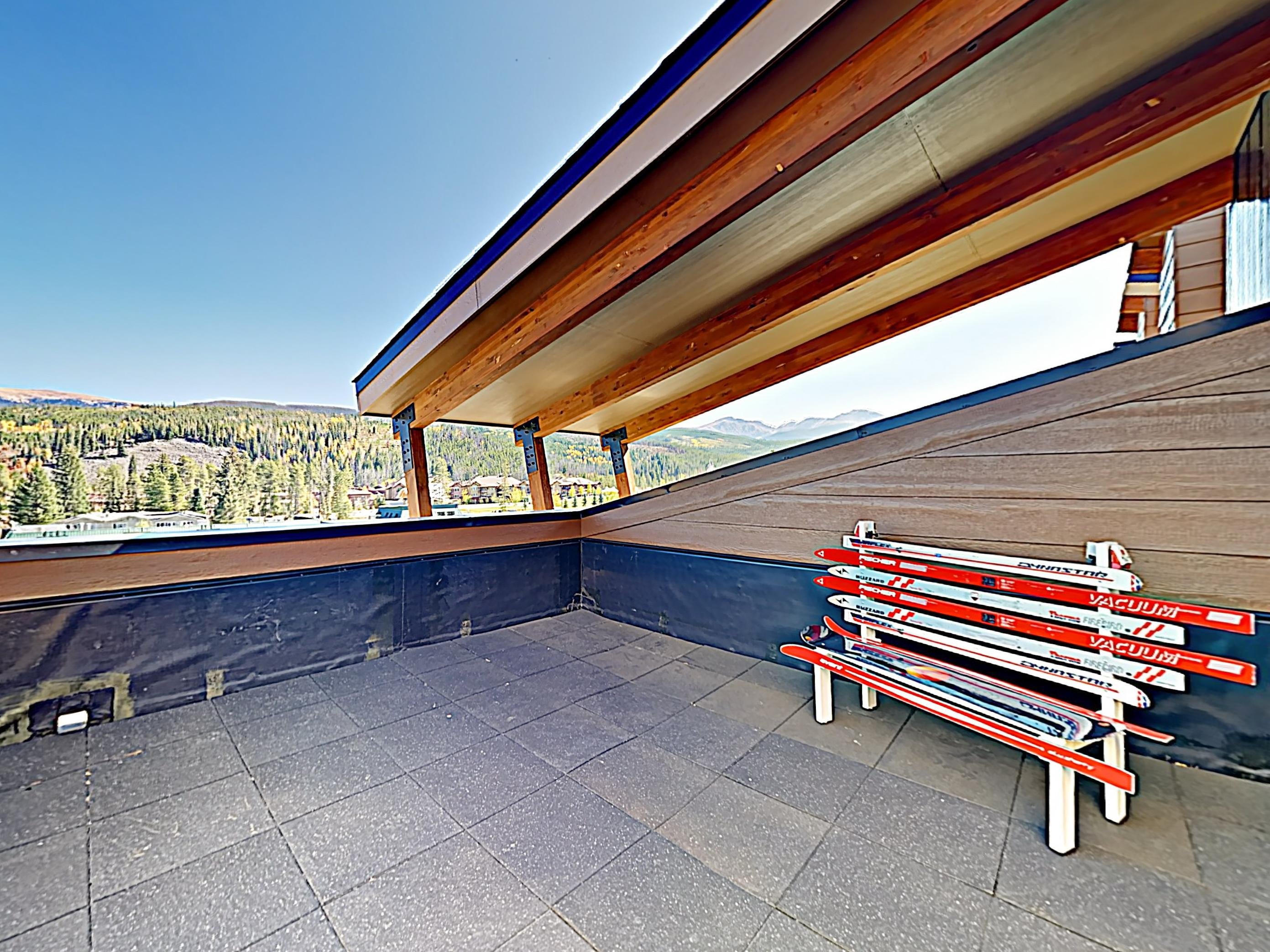 Find plenty of seating and gorgeous mountain vistas on your private rooftop deck.