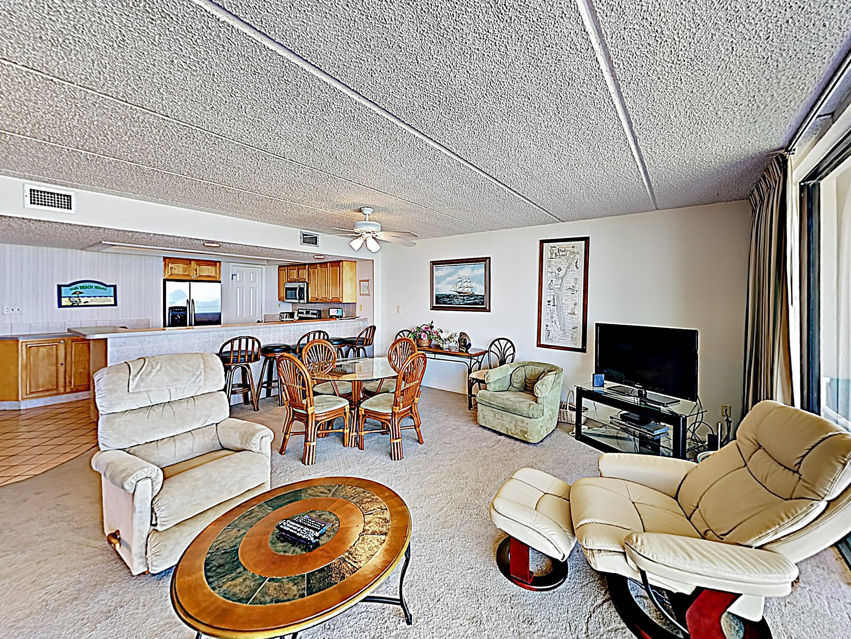 "The living area features plenty of plush seating and a 40"" flat-screen TV."