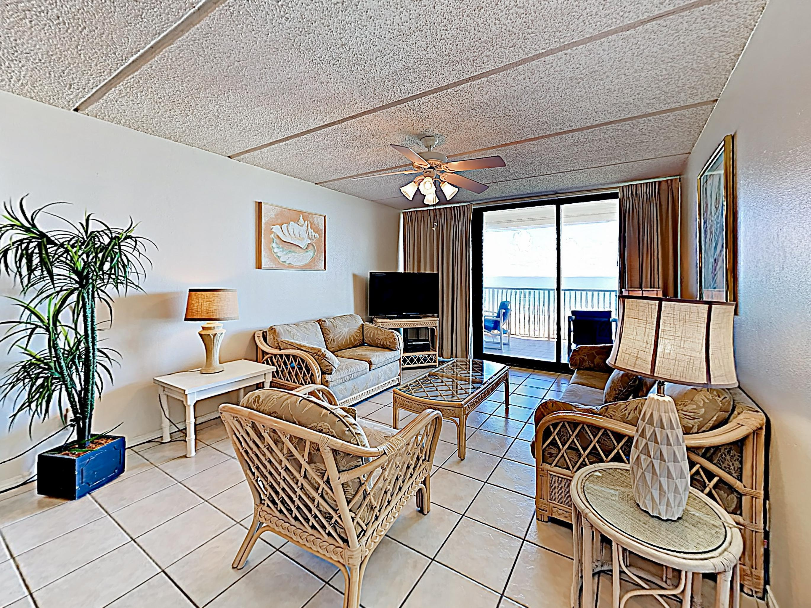 "Unwind into vacation mode in the living room, featuring a full-size sleeper sofa, love seat, armchair, and 40"" TV with DVD player."