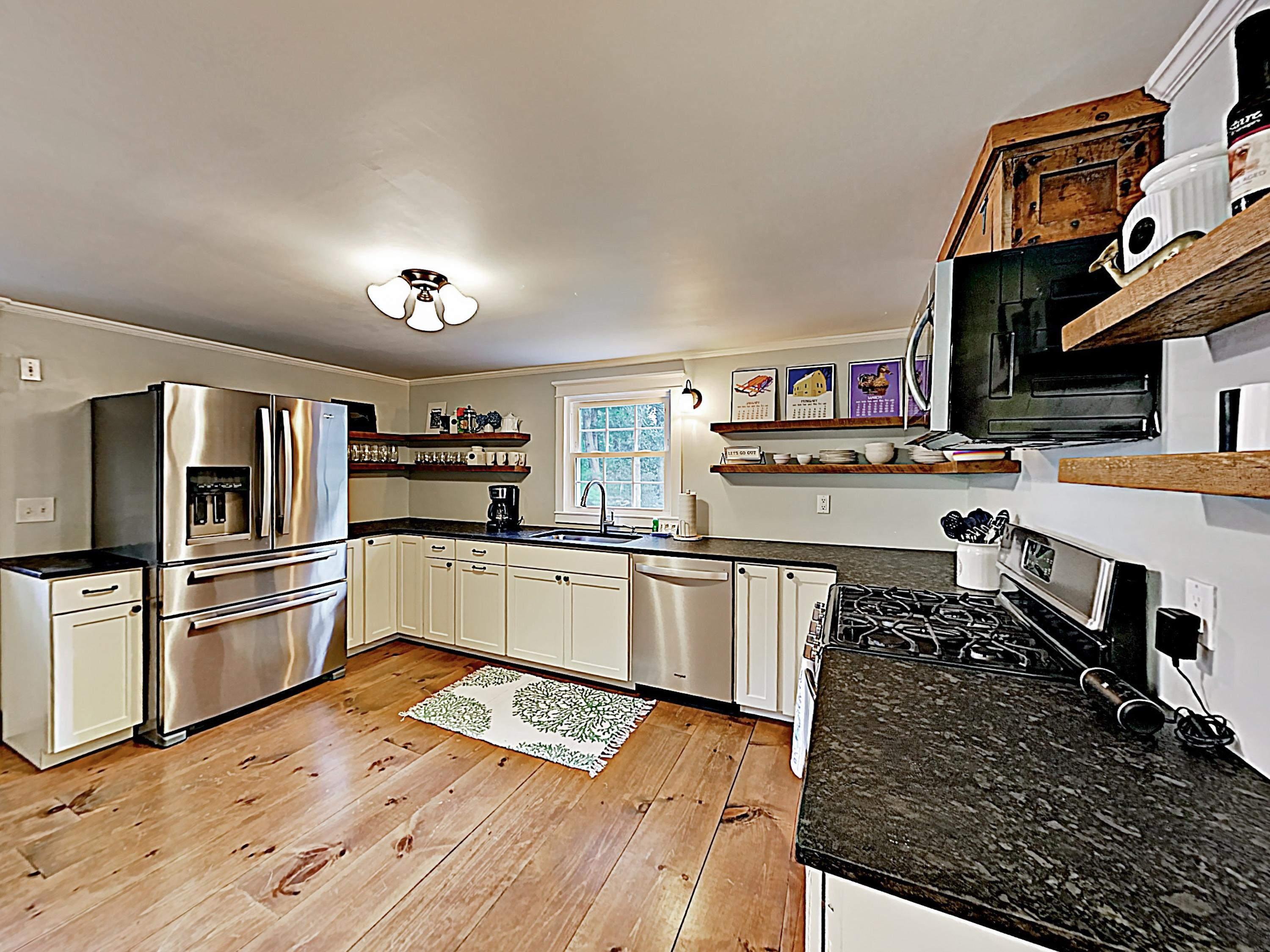 A spacious kitchen has plenty of counter space and a full suite of stainless steel appliances.