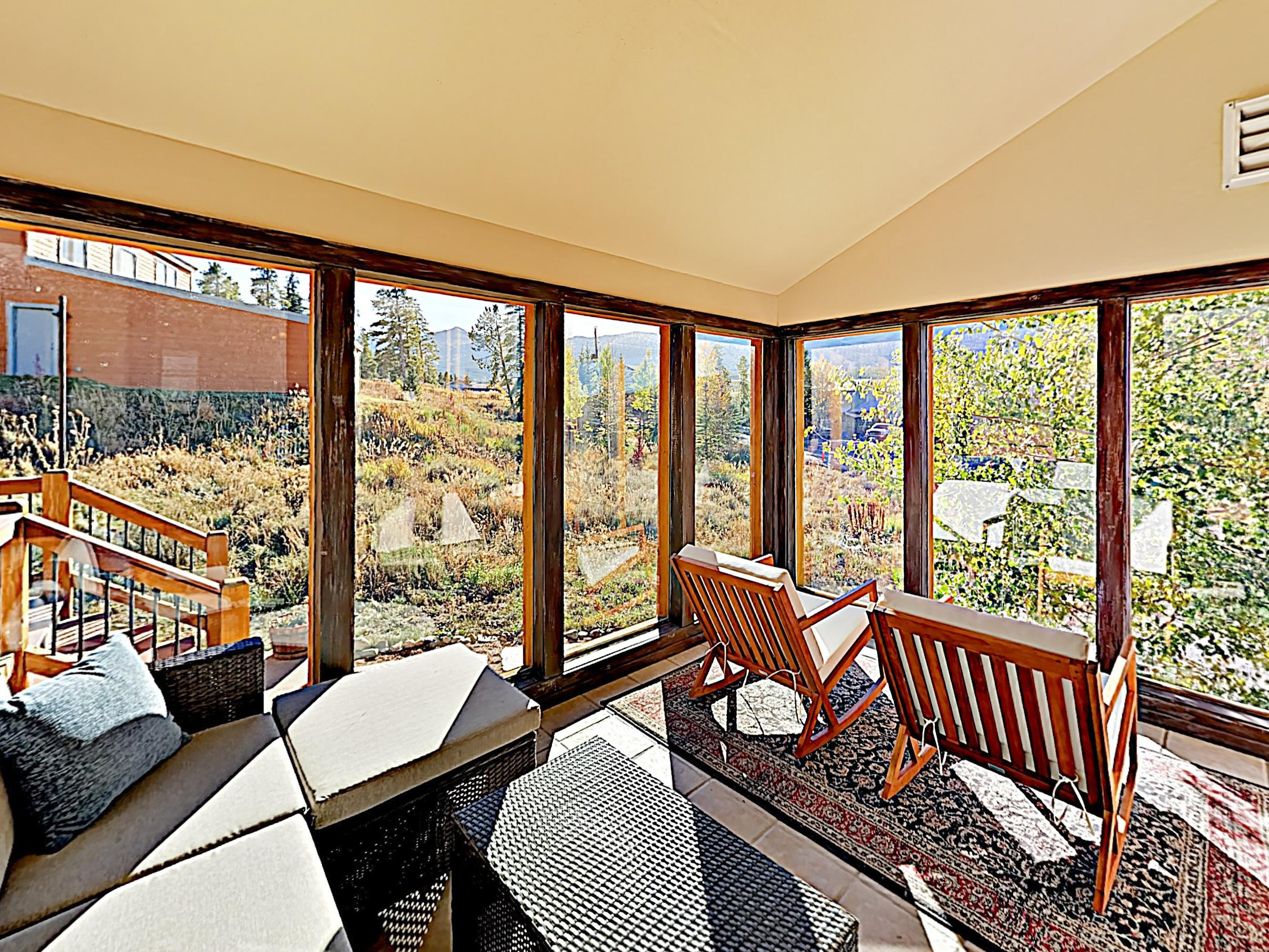 Discover panoramic views in the cozy sunroom.