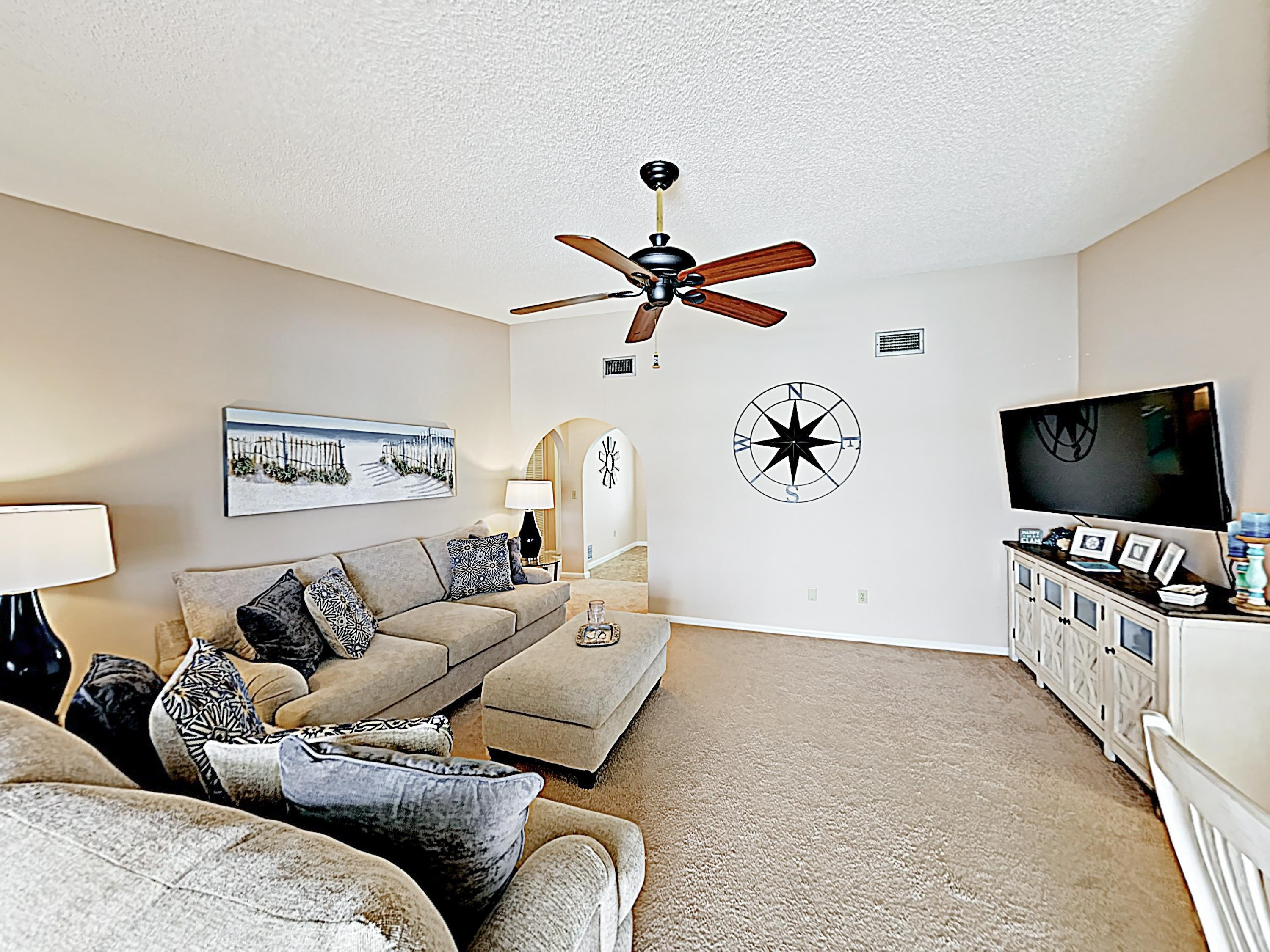 "Kick back in an open living area with a 60"" flat-screen TV and comfy furniture."