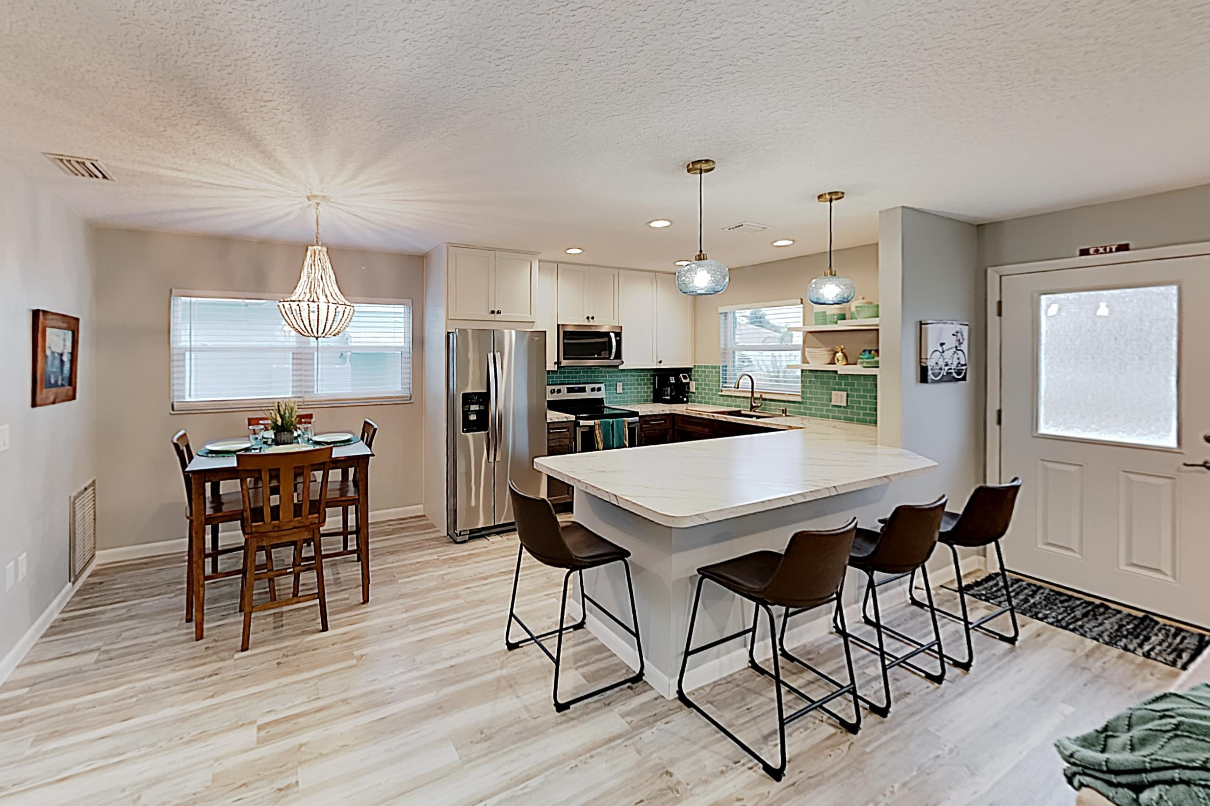 Whip up tasty meals in the renovated kitchen, appointed with a full suite of stainless steel appliances.