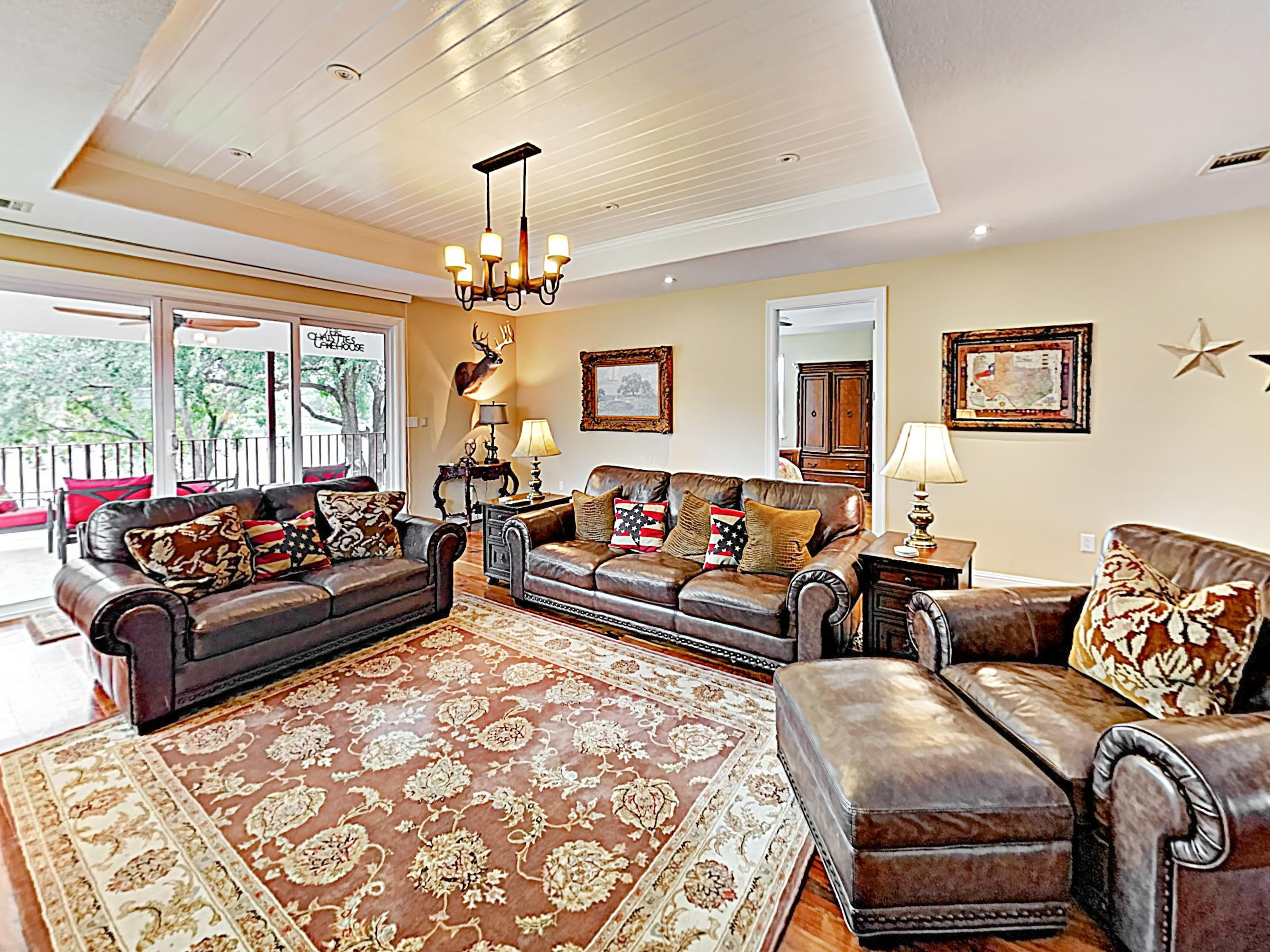 Make yourself at home in the lake house living room, equipped with plenty of plush seating and an electric fireplace.