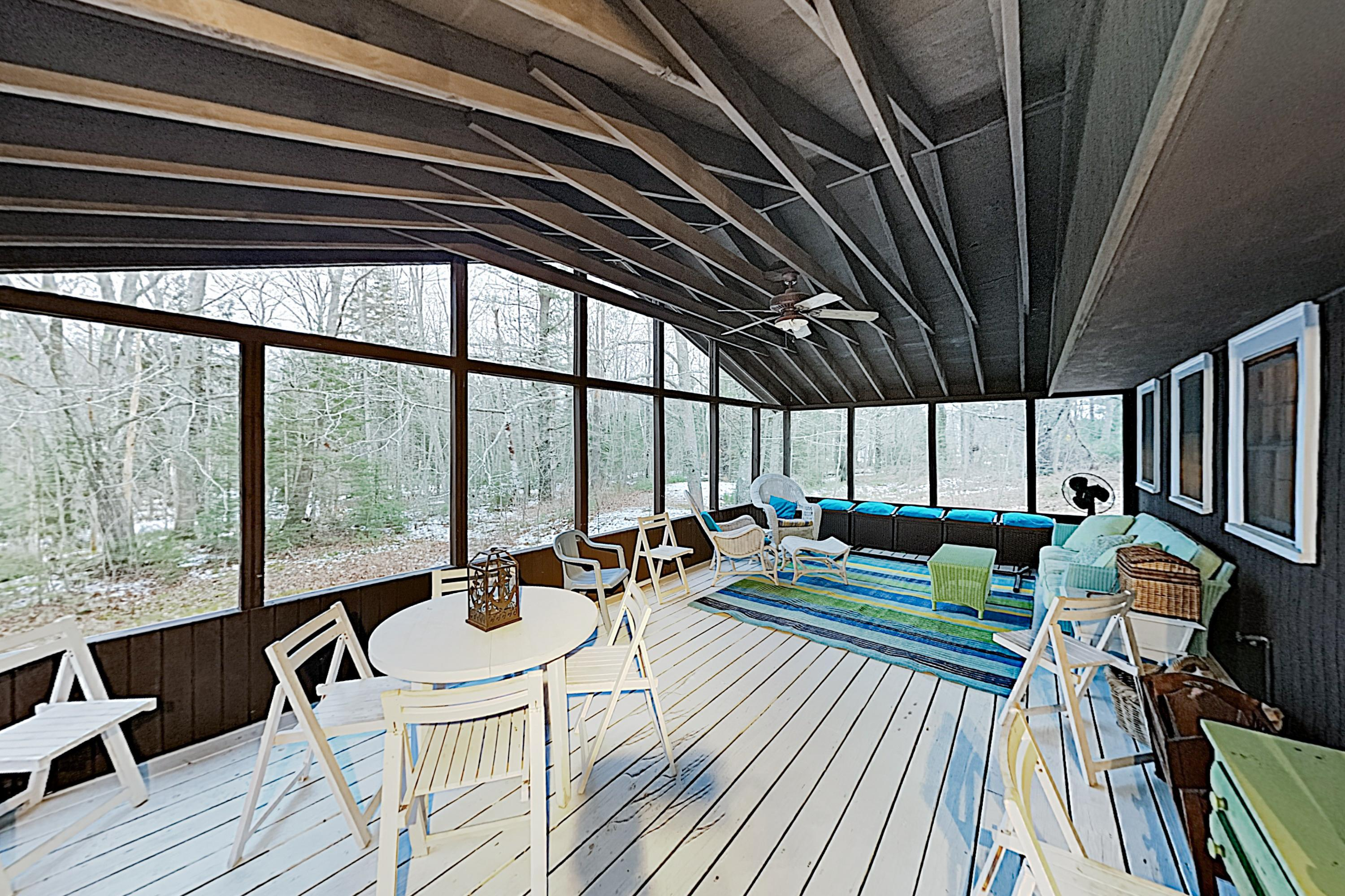 Enjoy the mild coastal climate on the screened porch.