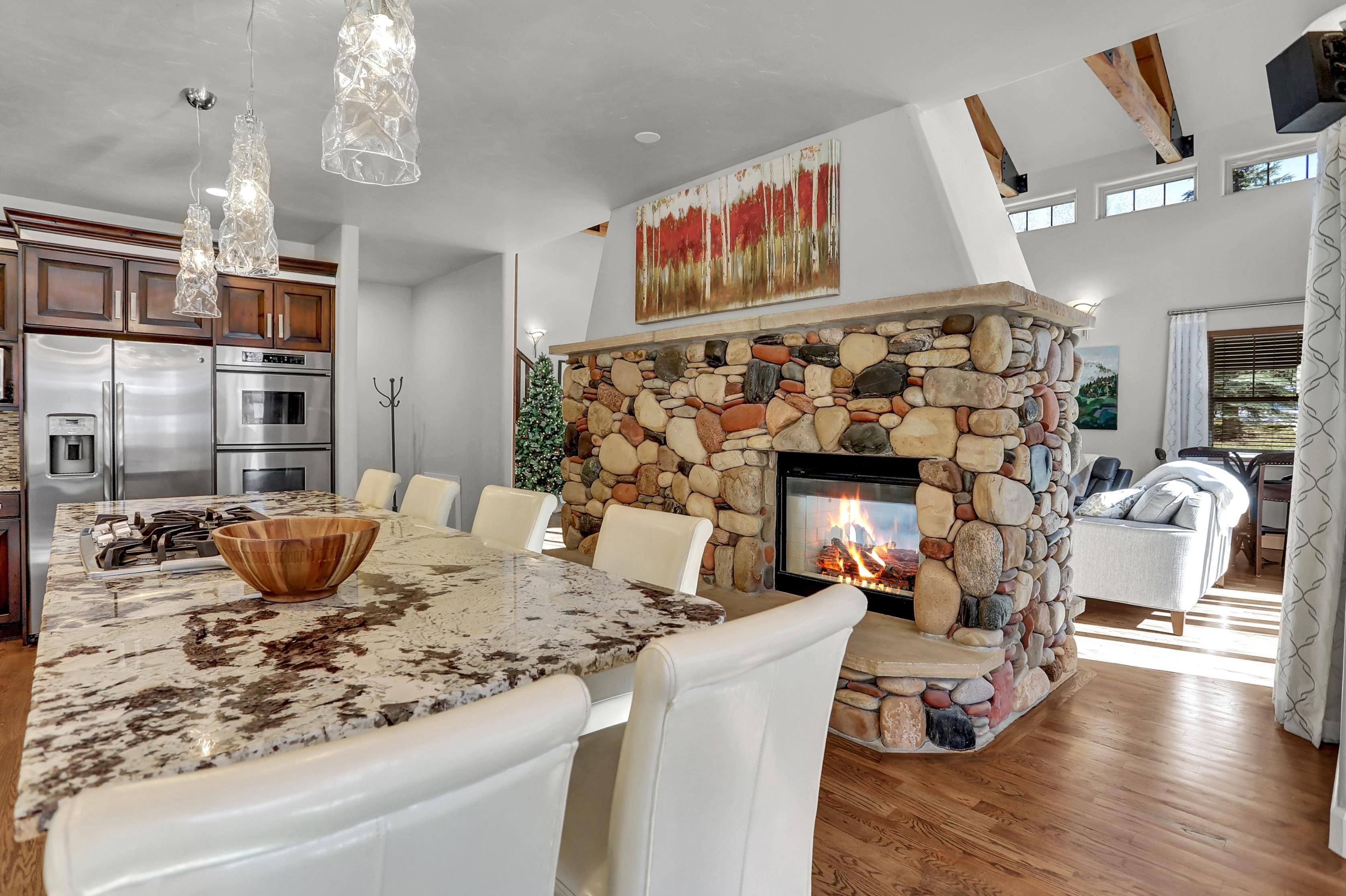 Stay cozy next to the double-sided fireplace found in the kitchen and living area.