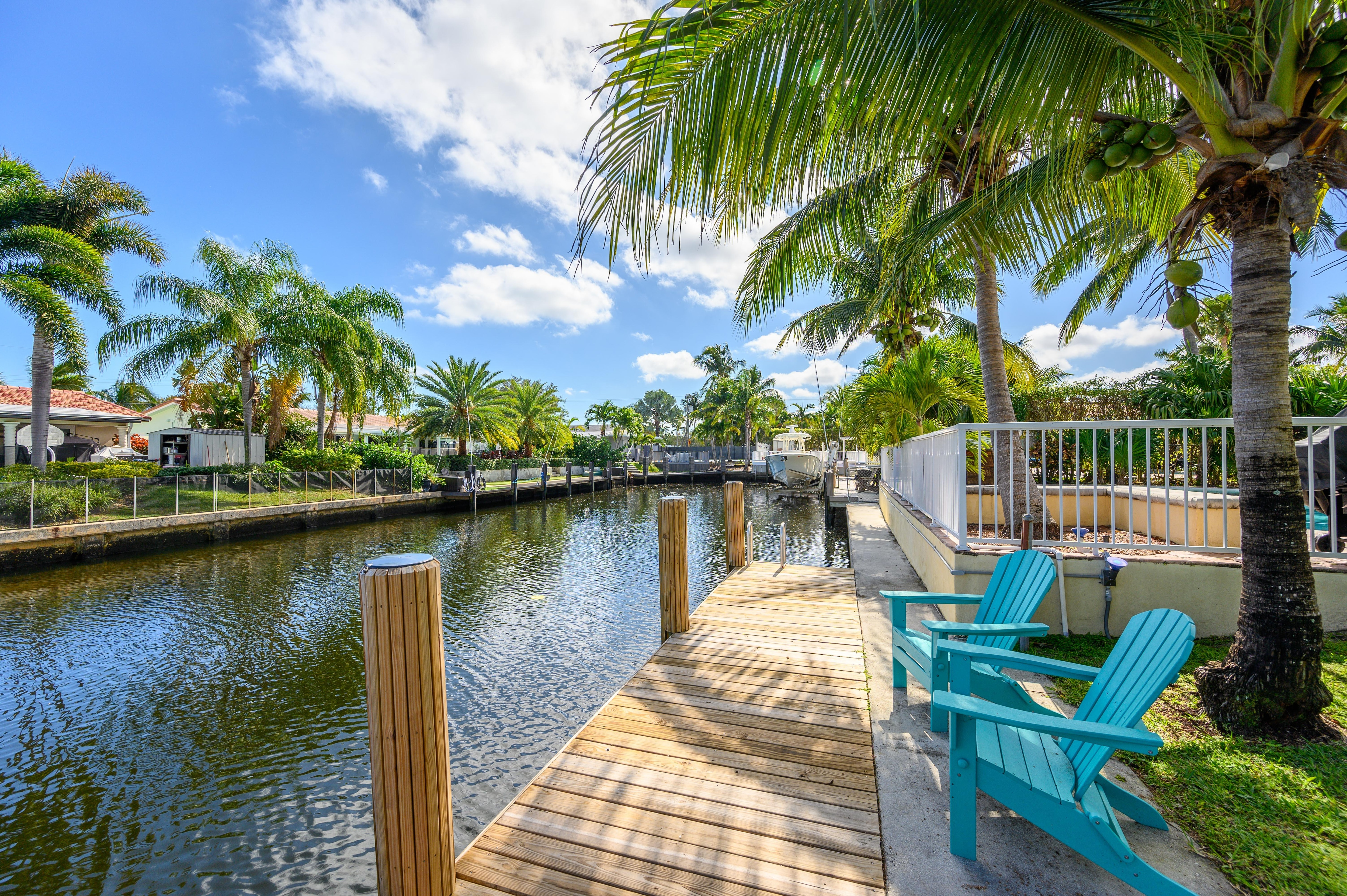 Feel the breeze through the palm trees as you unwind on your private dock.