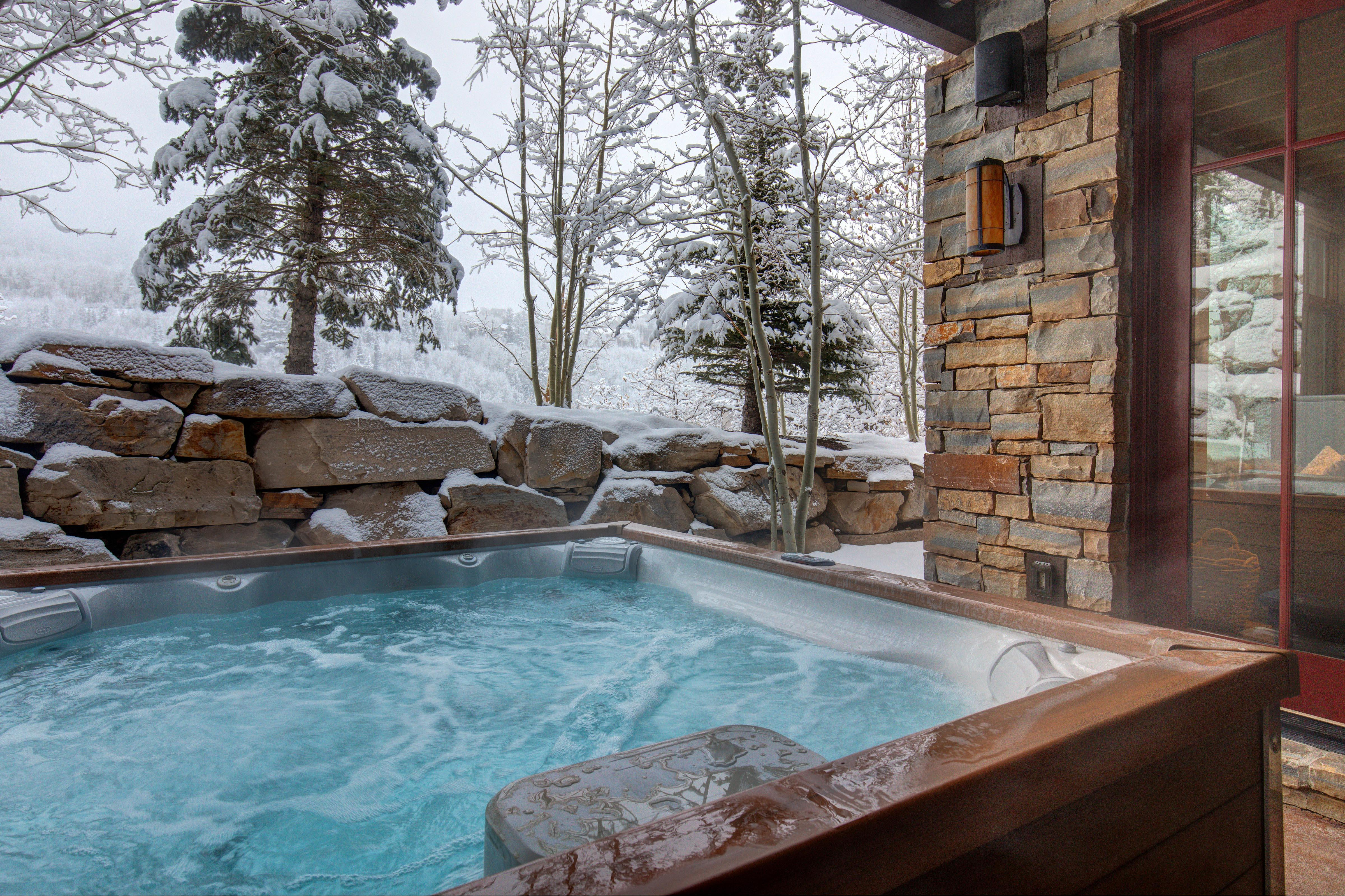 Enjoy relaxing soaks in a private hot tub, located off the 3rd bedroom.