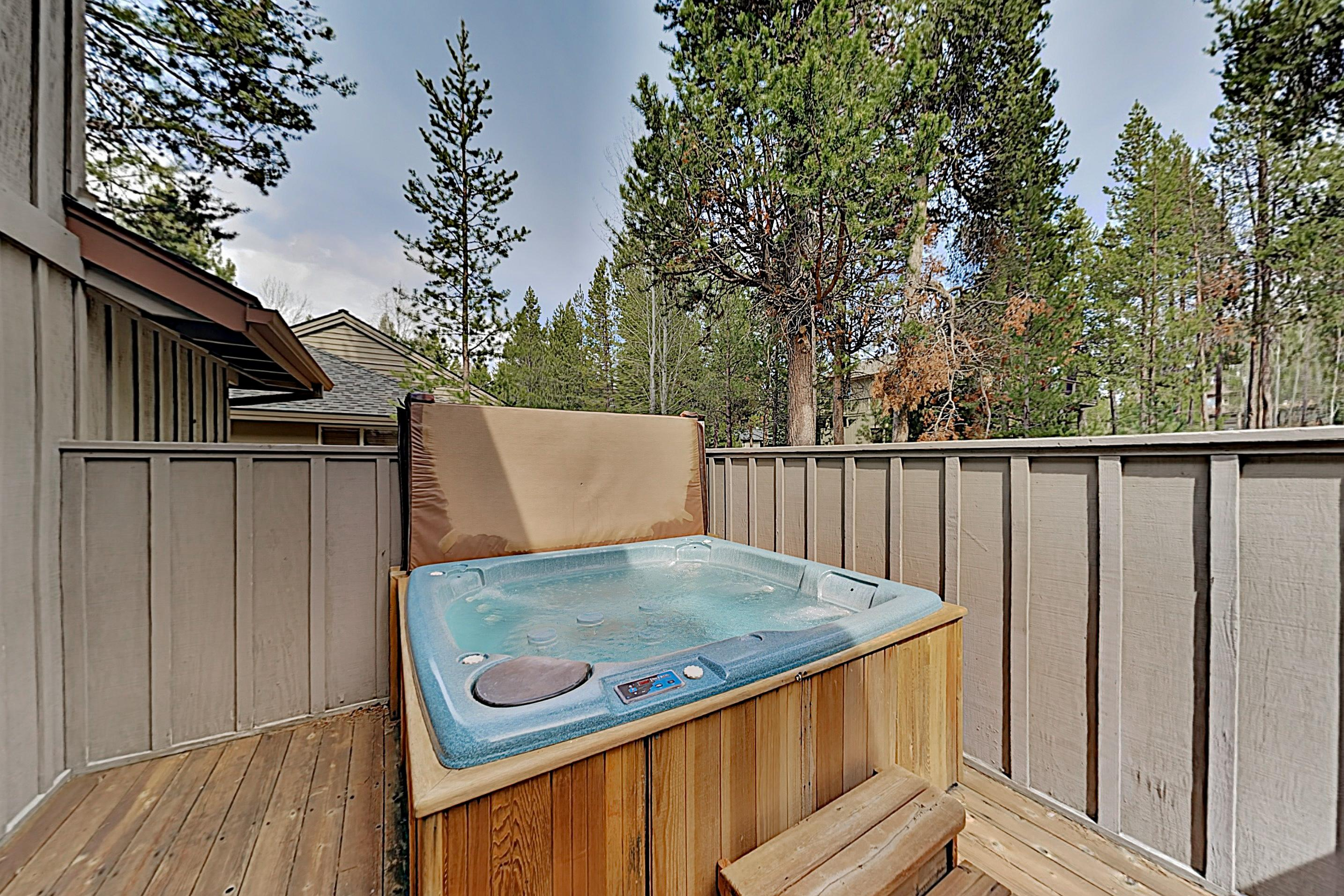 Take relaxing soaks in the private hot tub on the spacious deck.