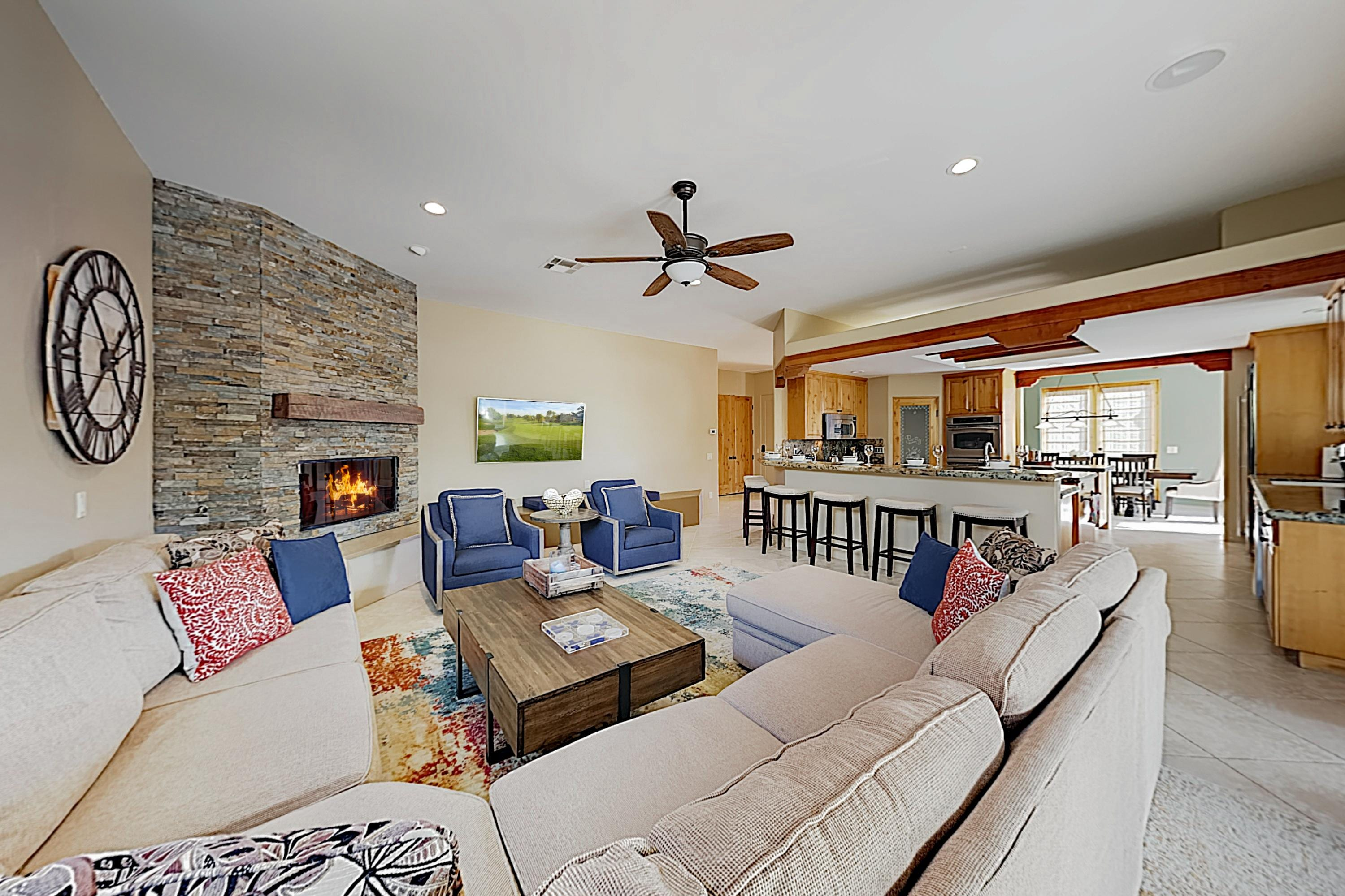 Unwind on the plush sectional and 2 armchairs in the living area.