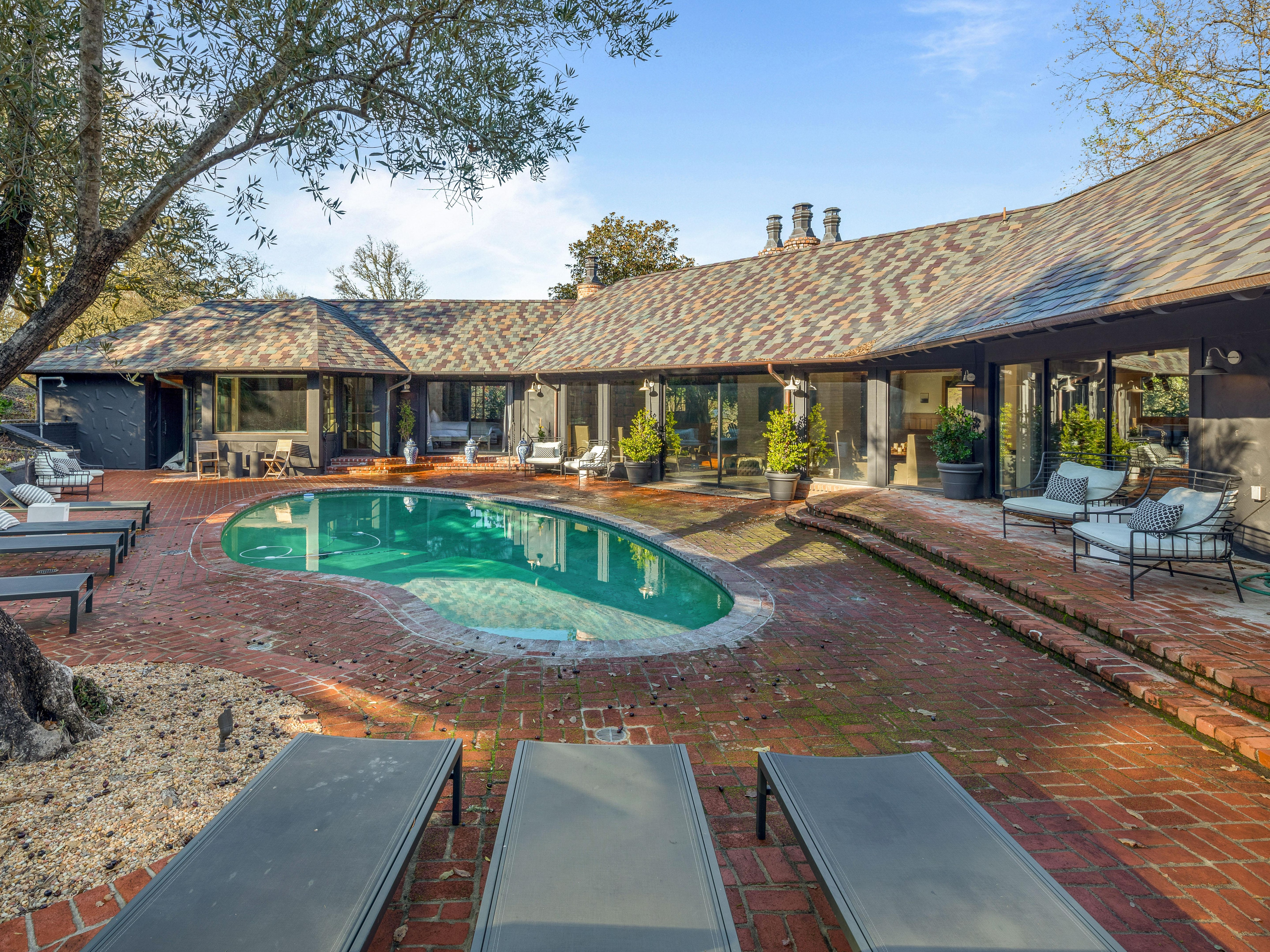 This property features a private garden oasis with a pool.