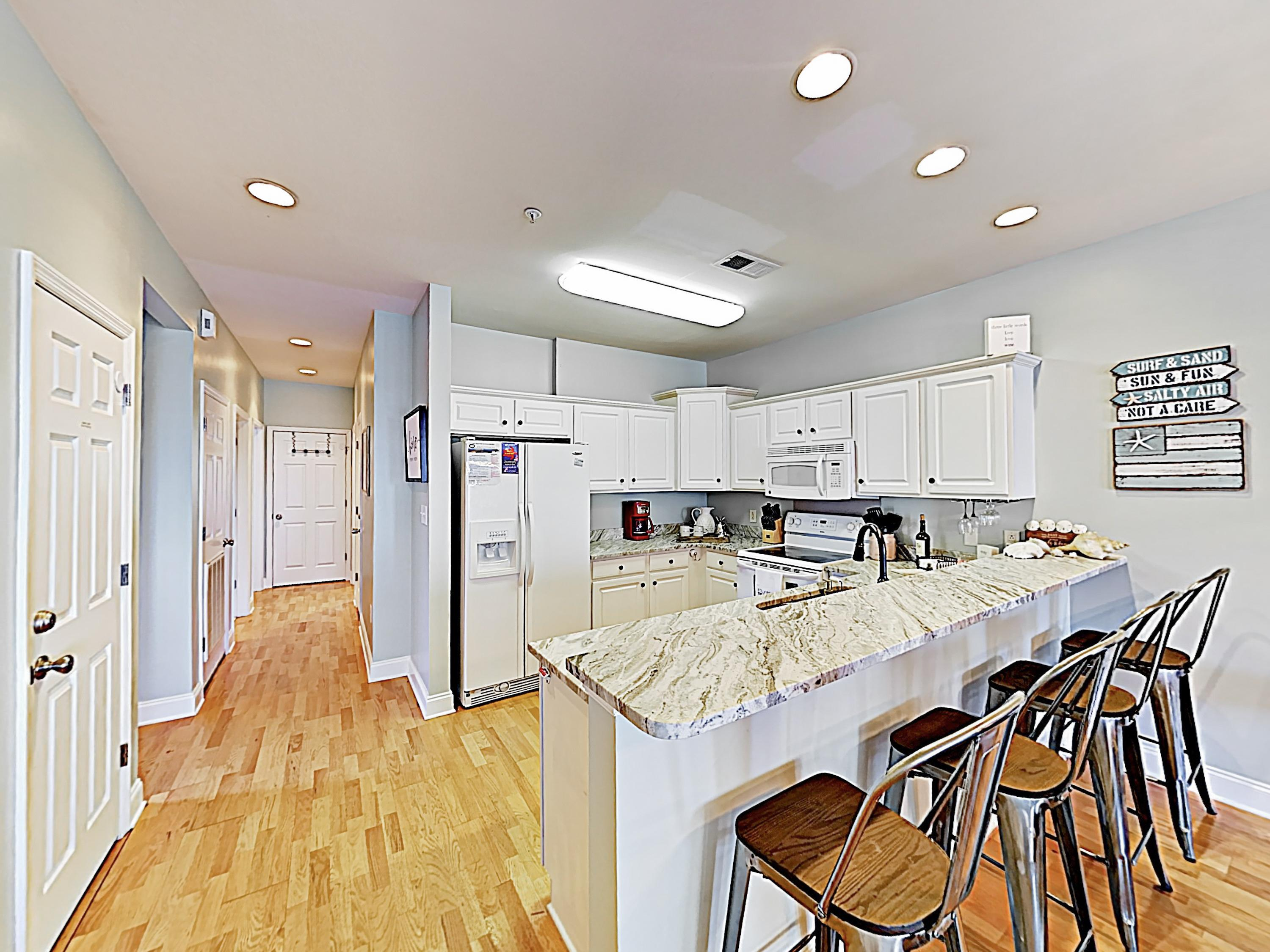 The well-appointed kitchen features a full suite of appliances.