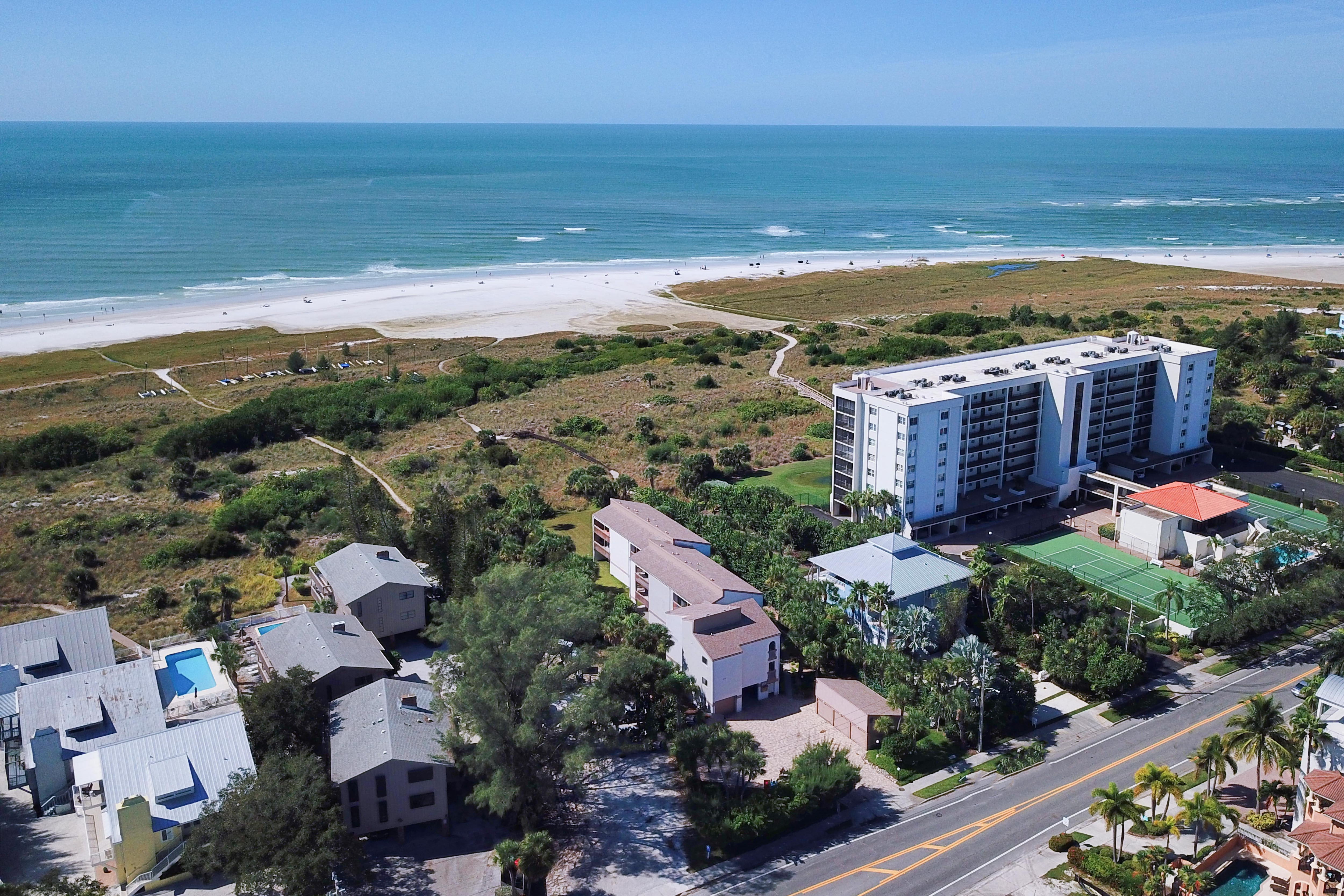Your rental (located in the center of the photo) offers a prime location with easy beach access.