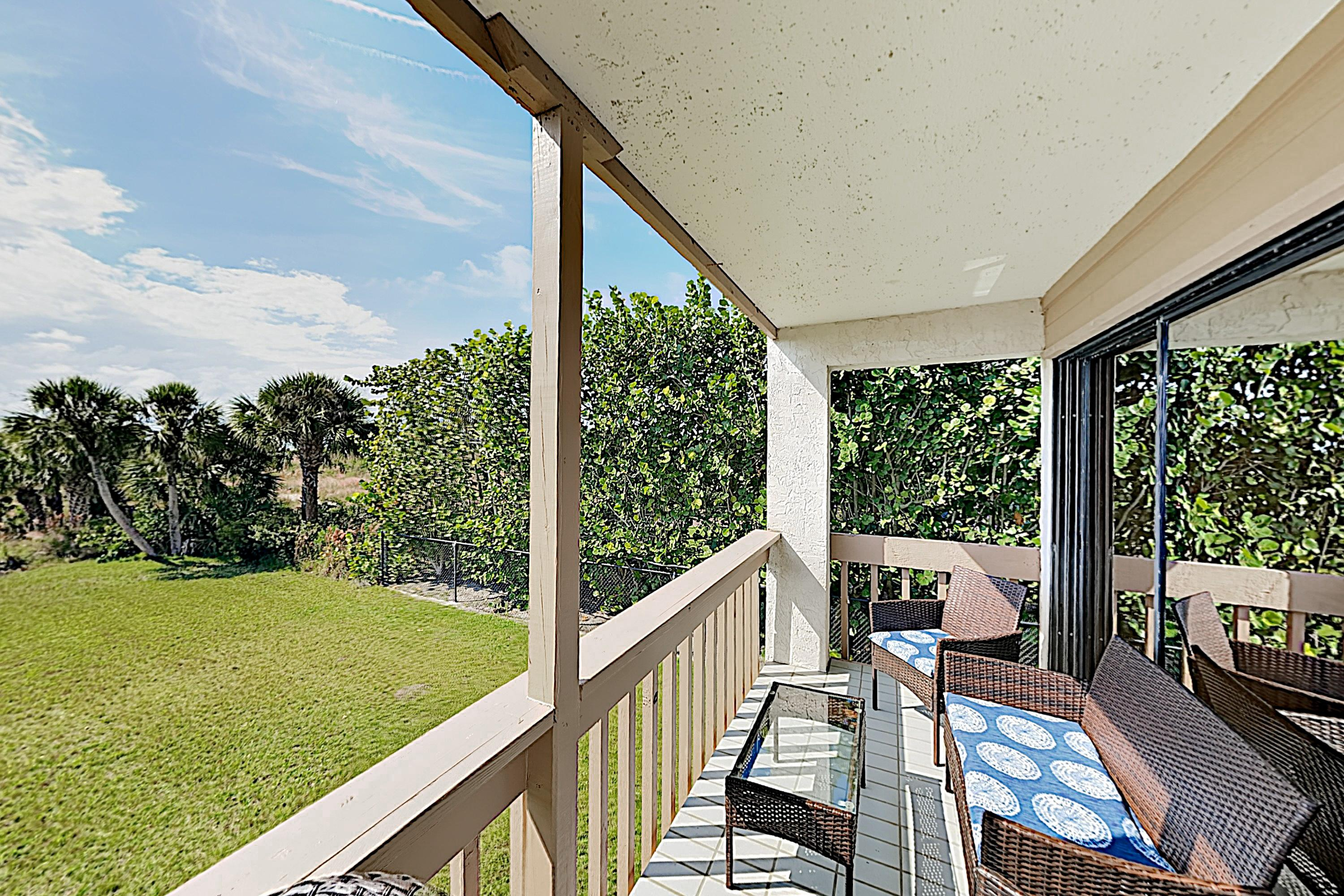 The balcony offers ample space to relax with a crisp beverage.