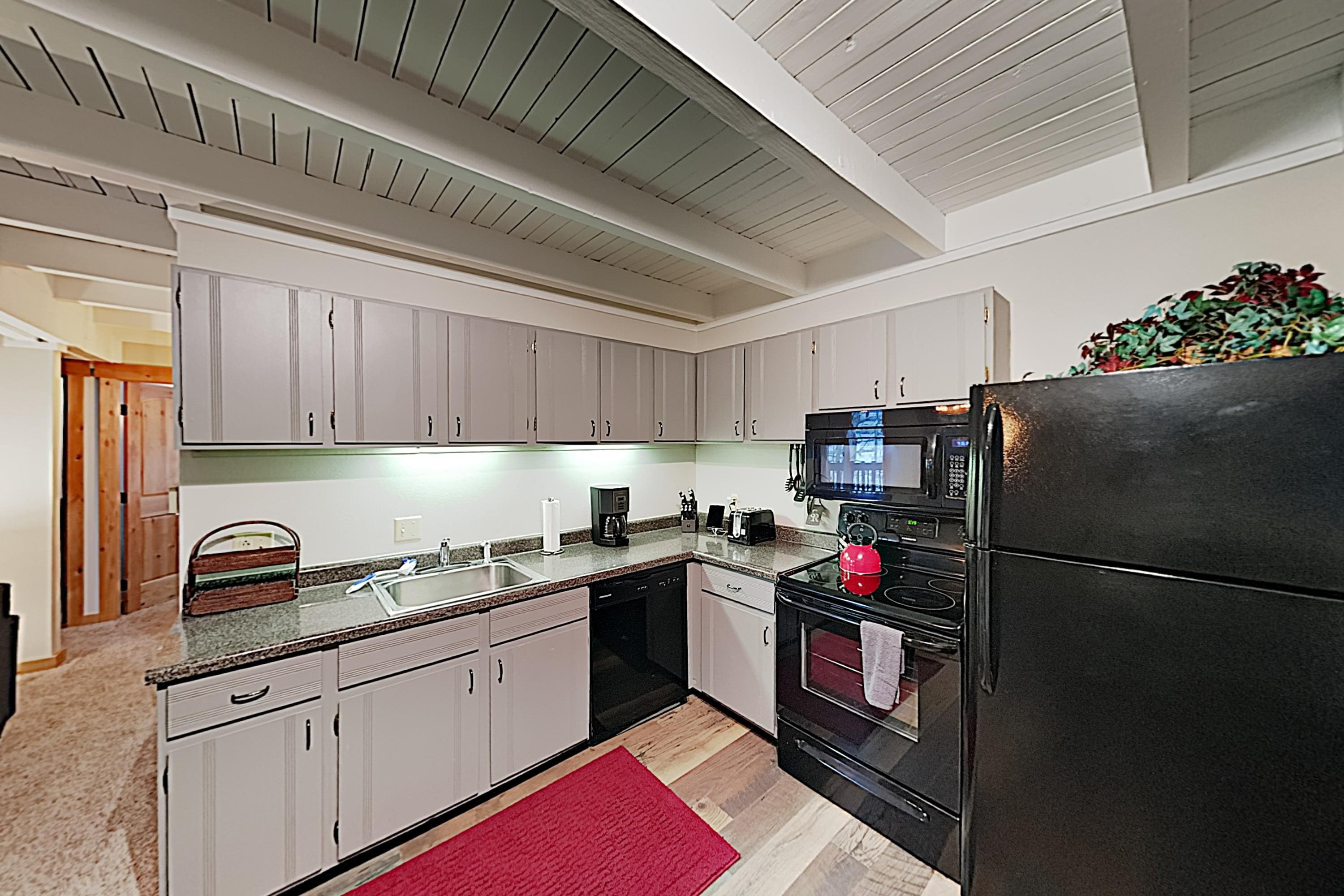 Whip up tasty meals in the well-equipped kitchen, which features a full suite of appliances and ample cookware.
