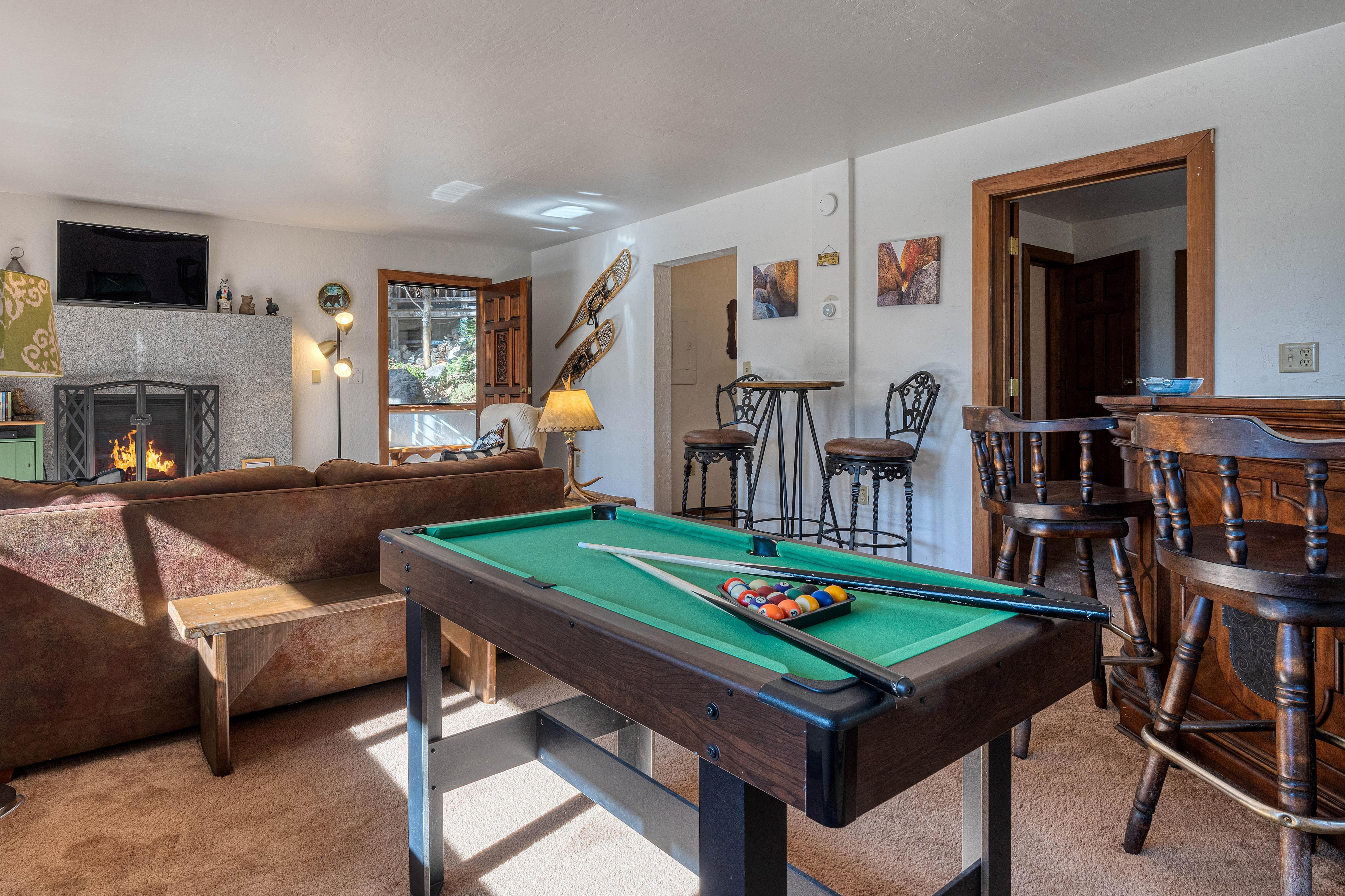 The master lounge features a mini pool table and a wet bar.