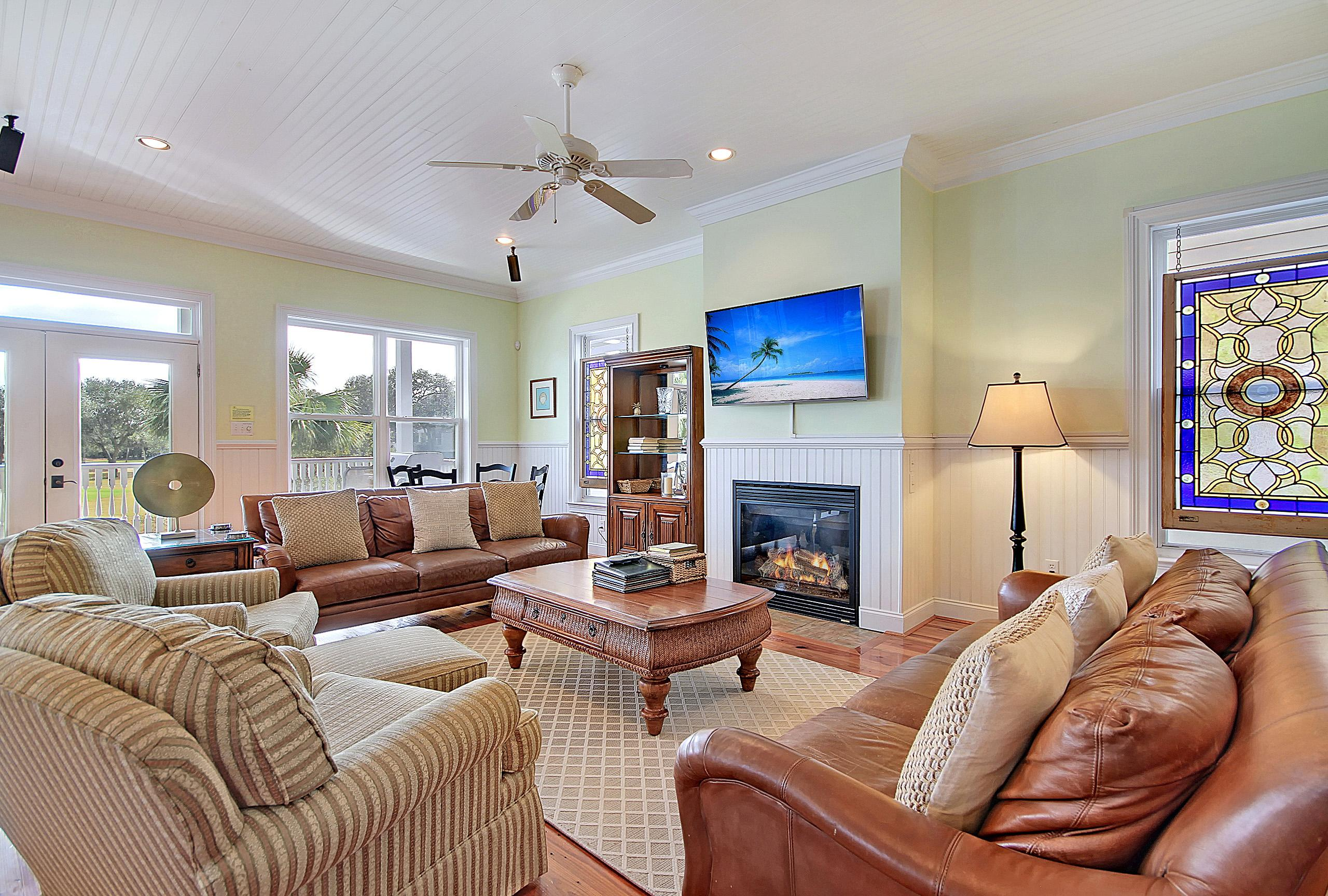 The living area features a gas fireplace, pine floors, and stained-glass windows.