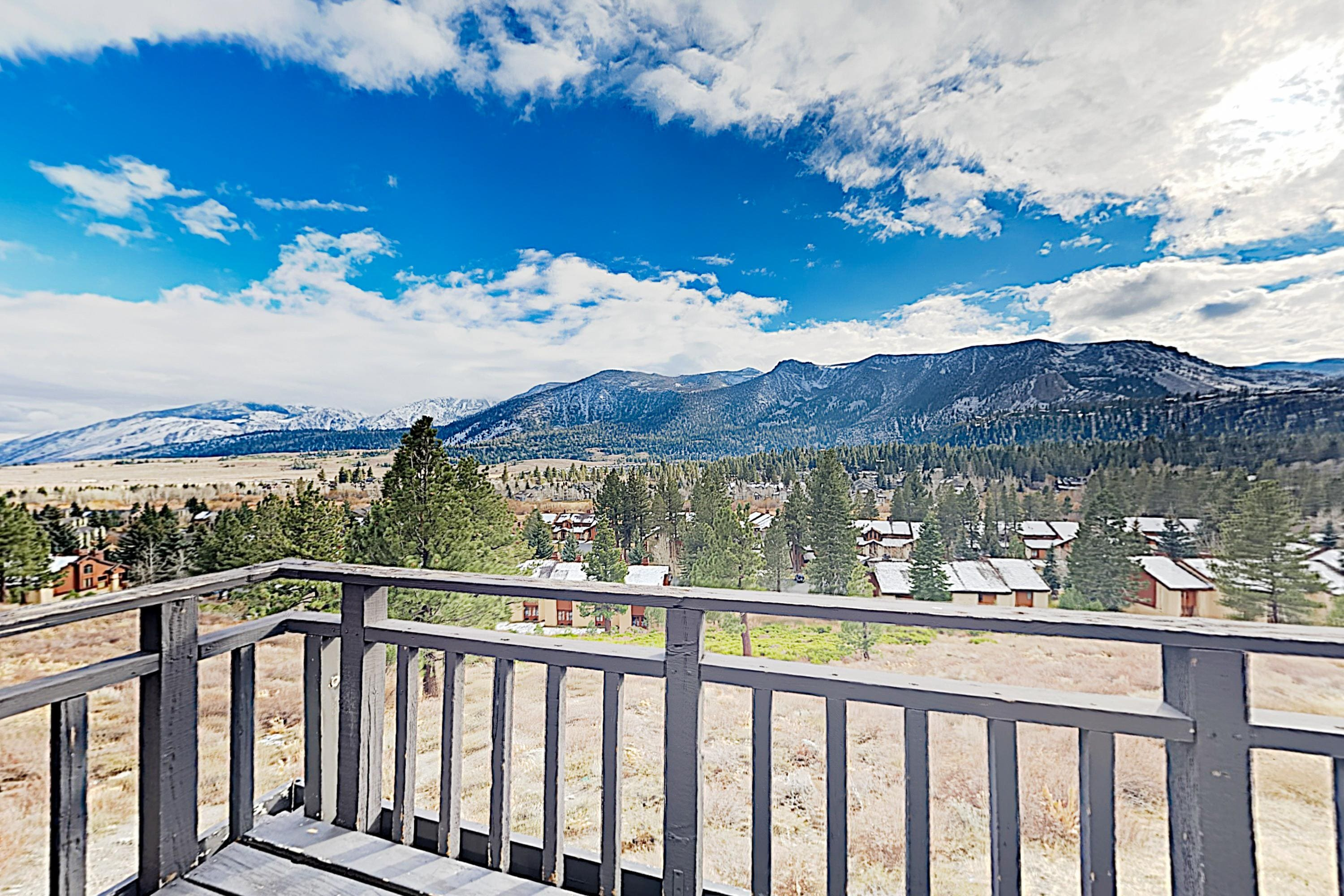 Admire sweeping views of the surrounding mountains from your private deck.