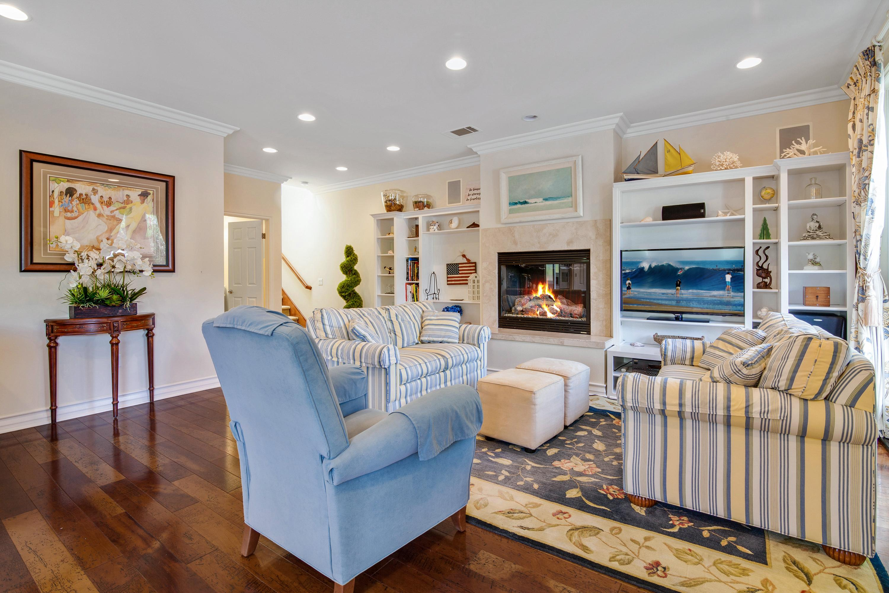 Unwind in an elegant living area with nautical-inspired decor and polished wooden floors.