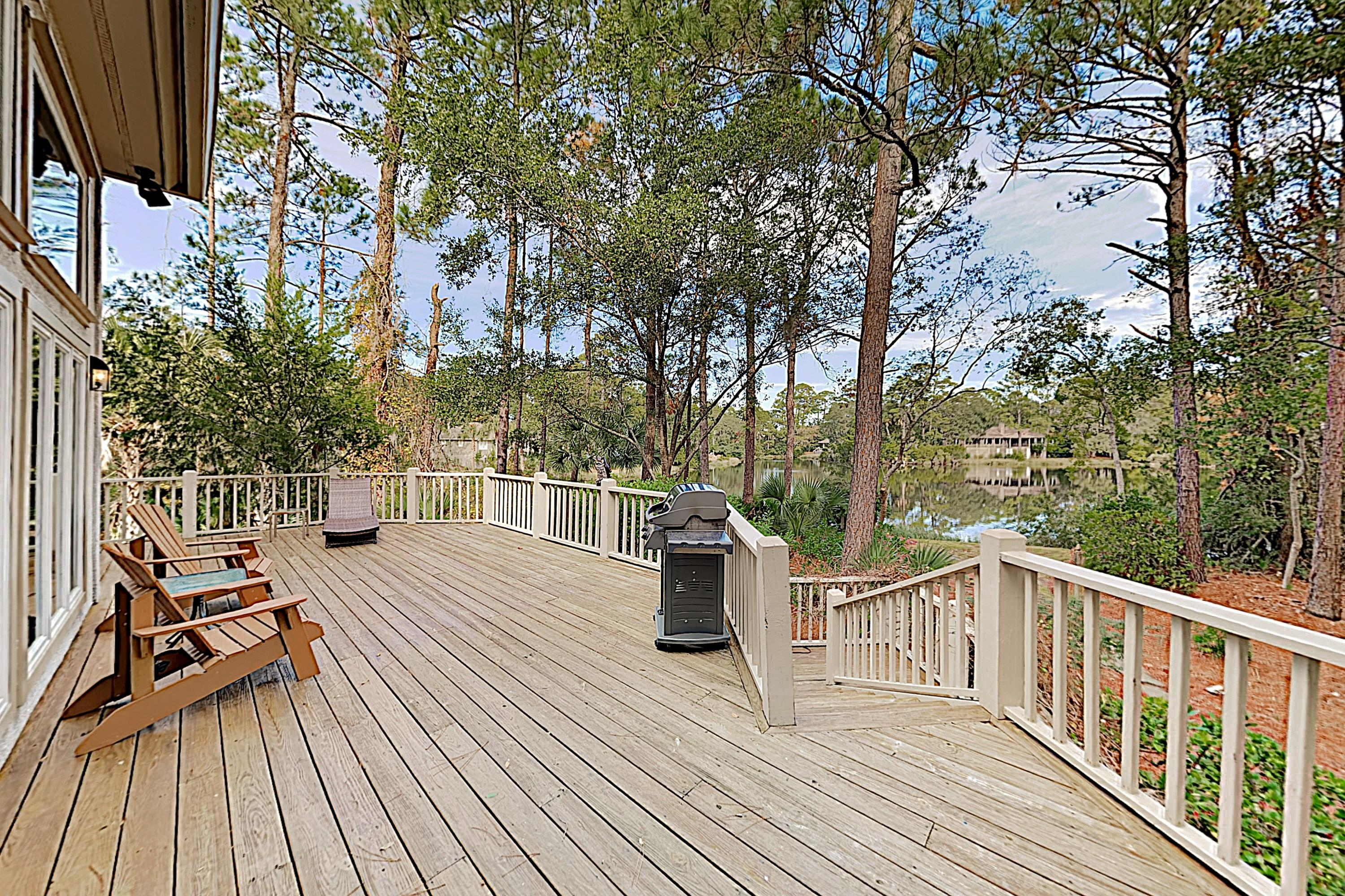 Sip drinks and admire peaceful pond views on the spacious back deck.